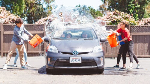 Four Children Washing Silver Toyota Prius