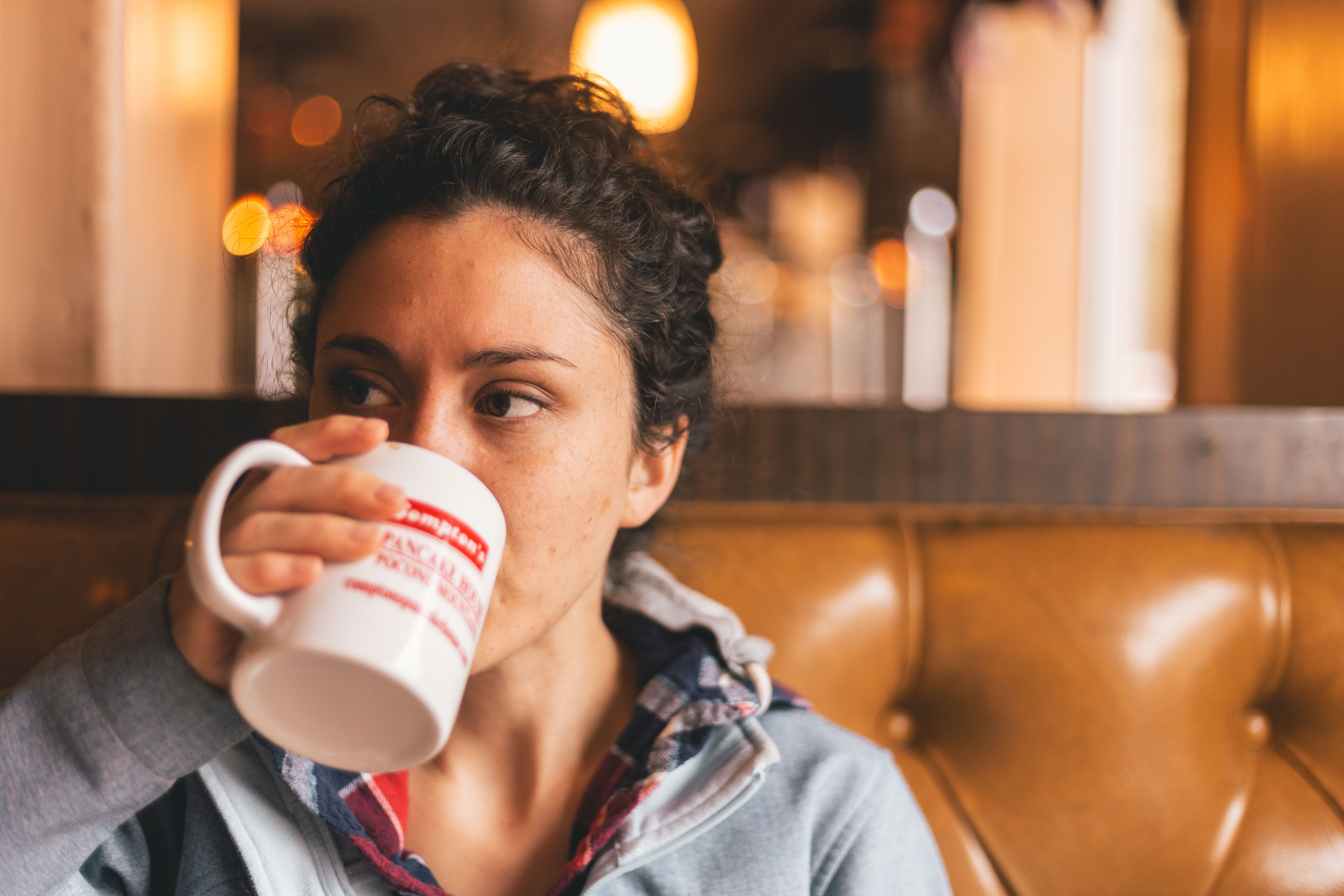 Woman Drinking Cup of Beverage