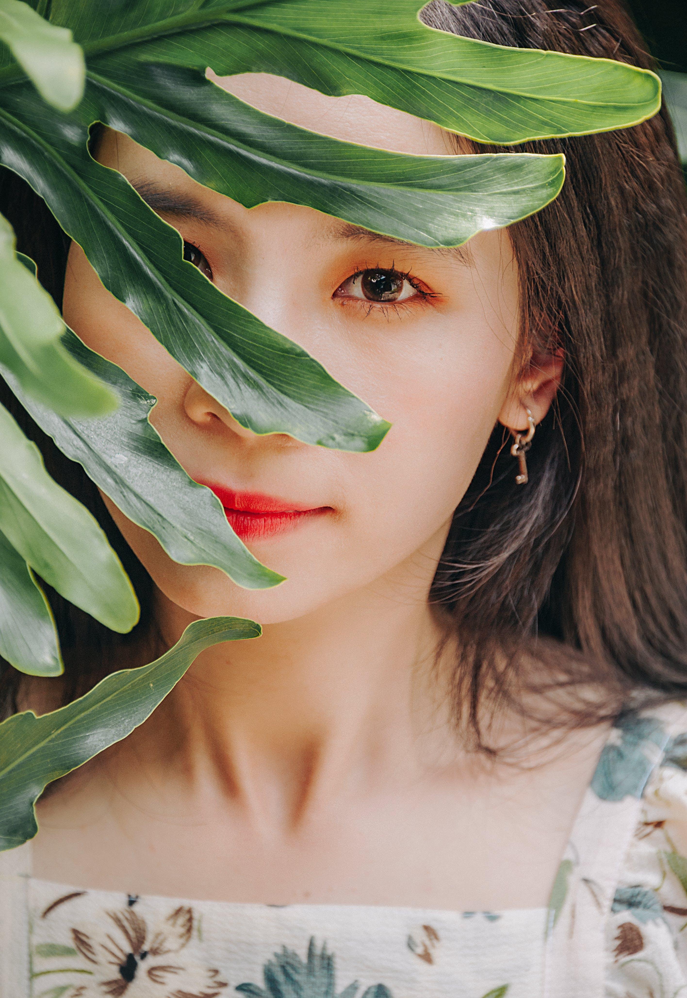 Woman Posing Behind Plant