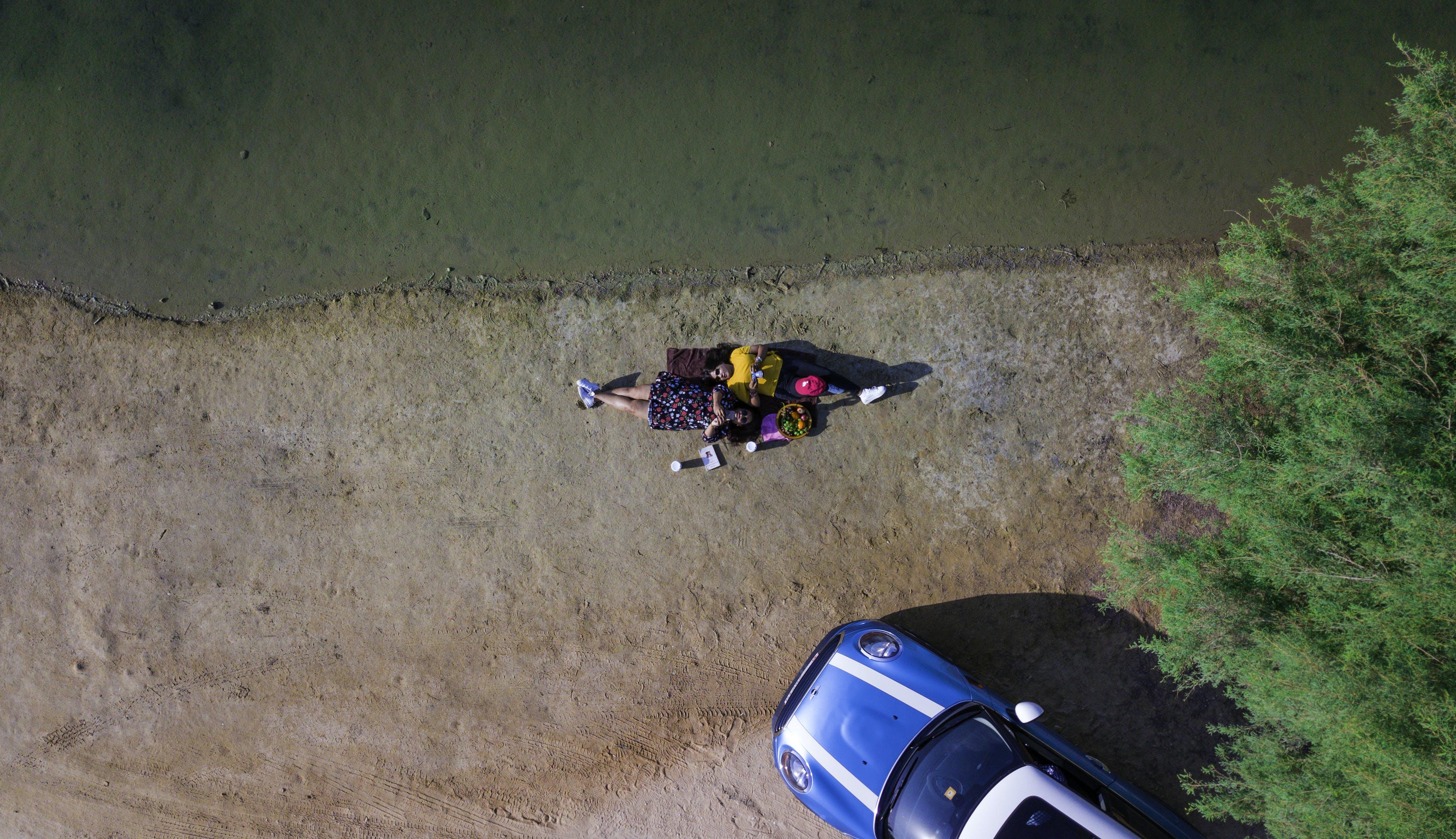 Aerial Photo of Women Lying on Ground