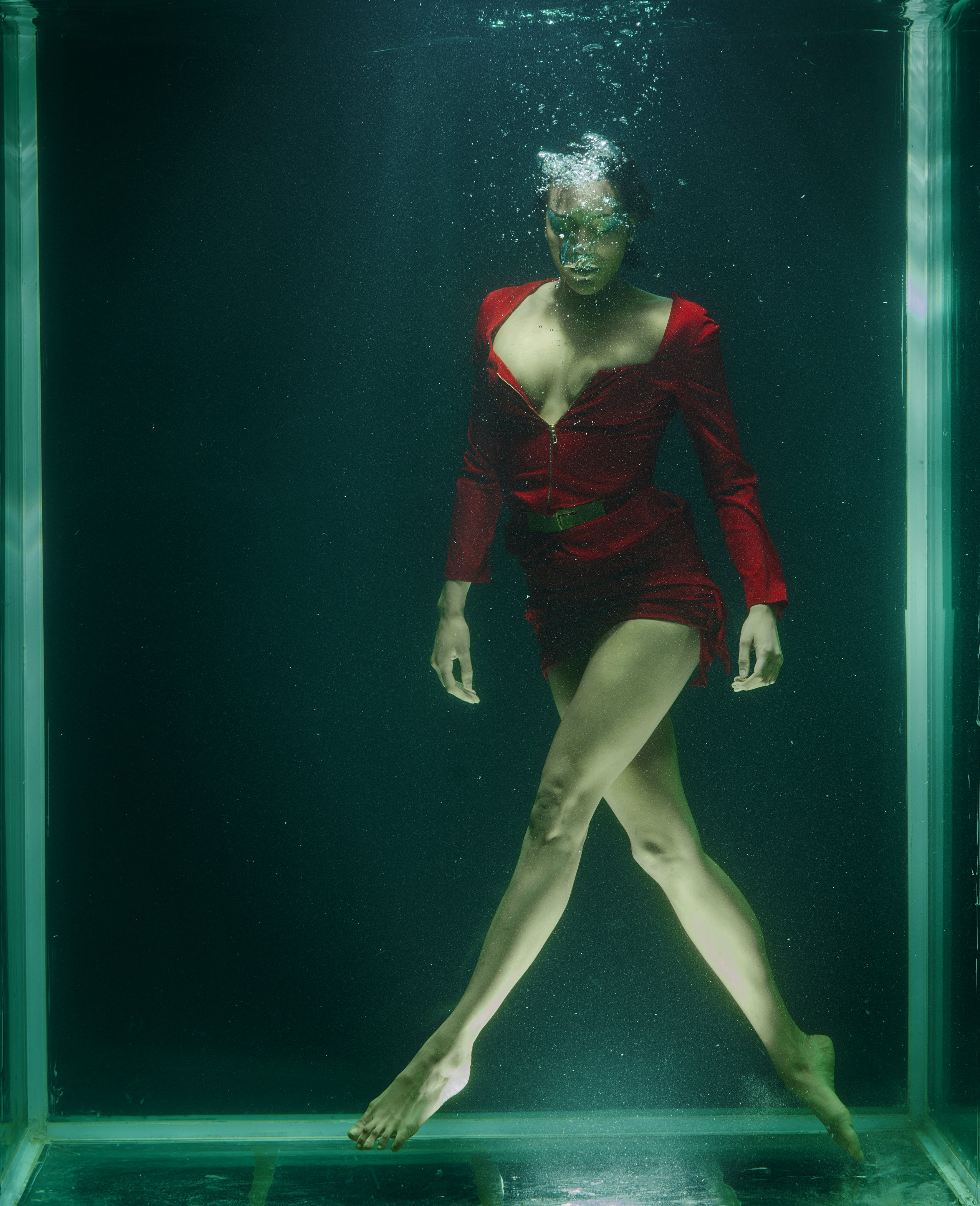 Woman Wearing Red Long-sleeved Shirt Underwater