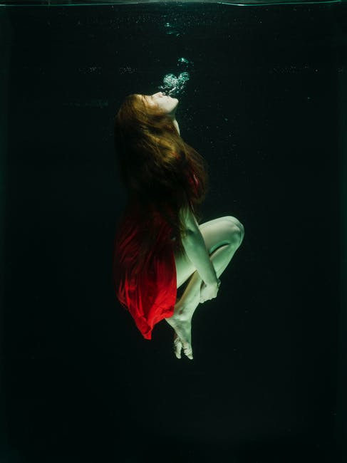 Underwater Photo of a Woman