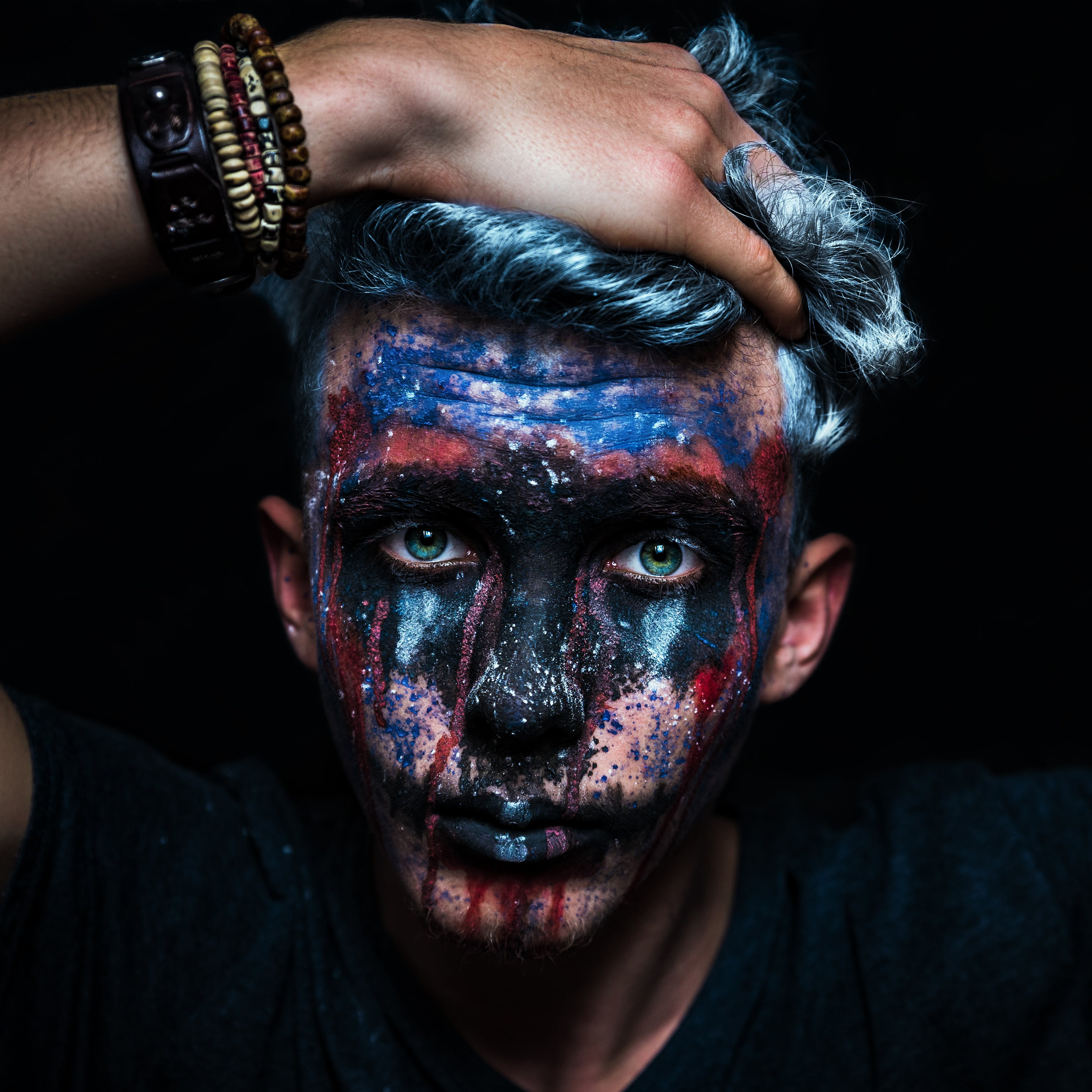 Close-Up Photo of a Man With Face Paint
