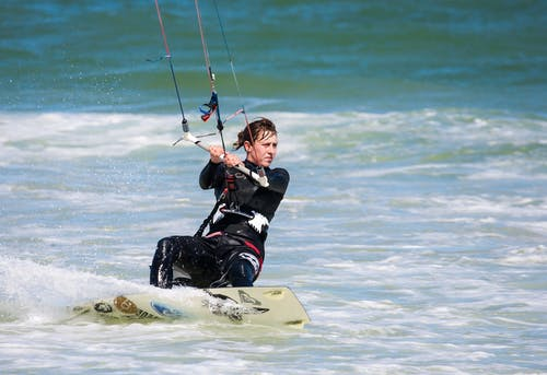 Kitesurfer on Body of Water