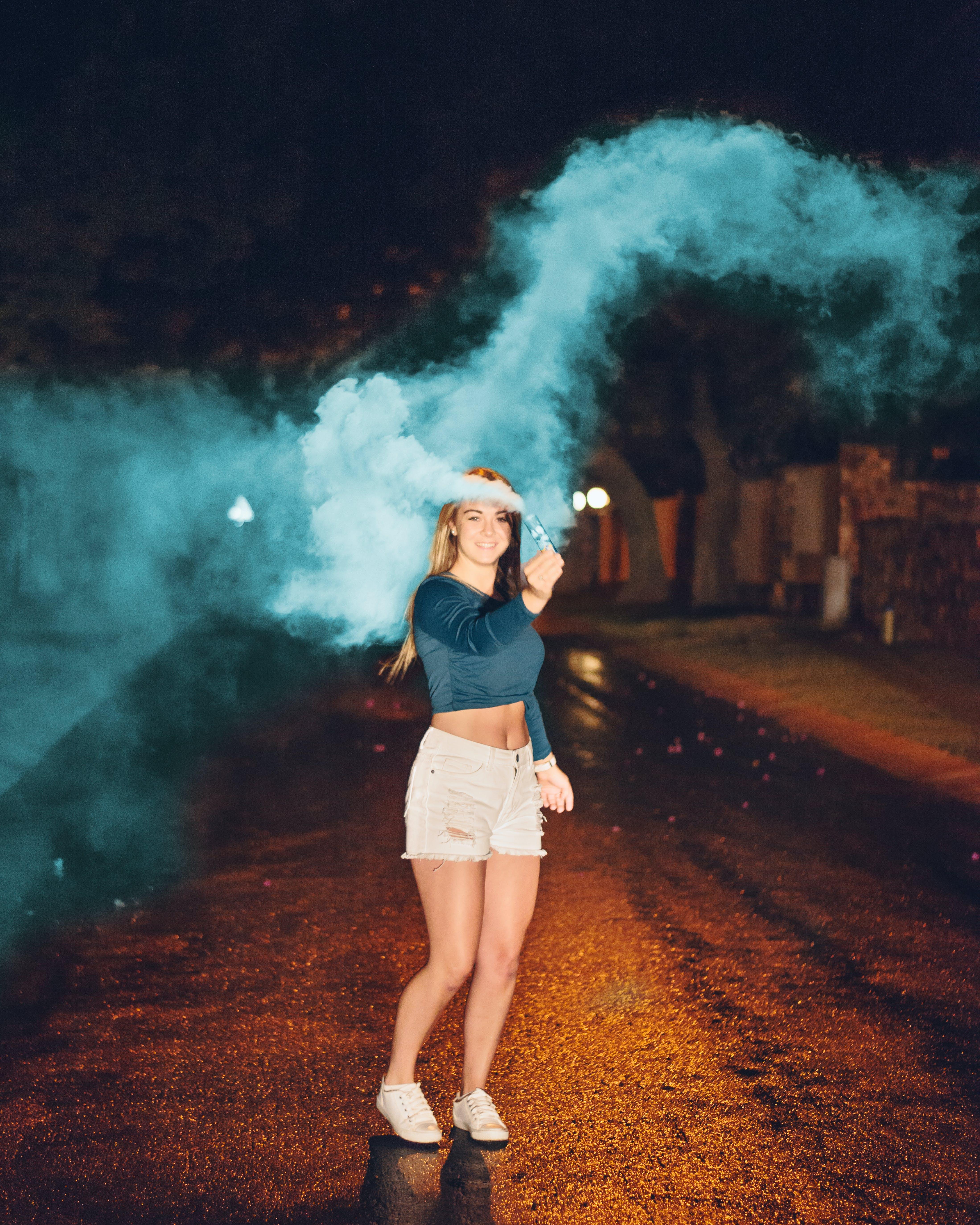 Photo of Woman Holding a Smoke Bomb