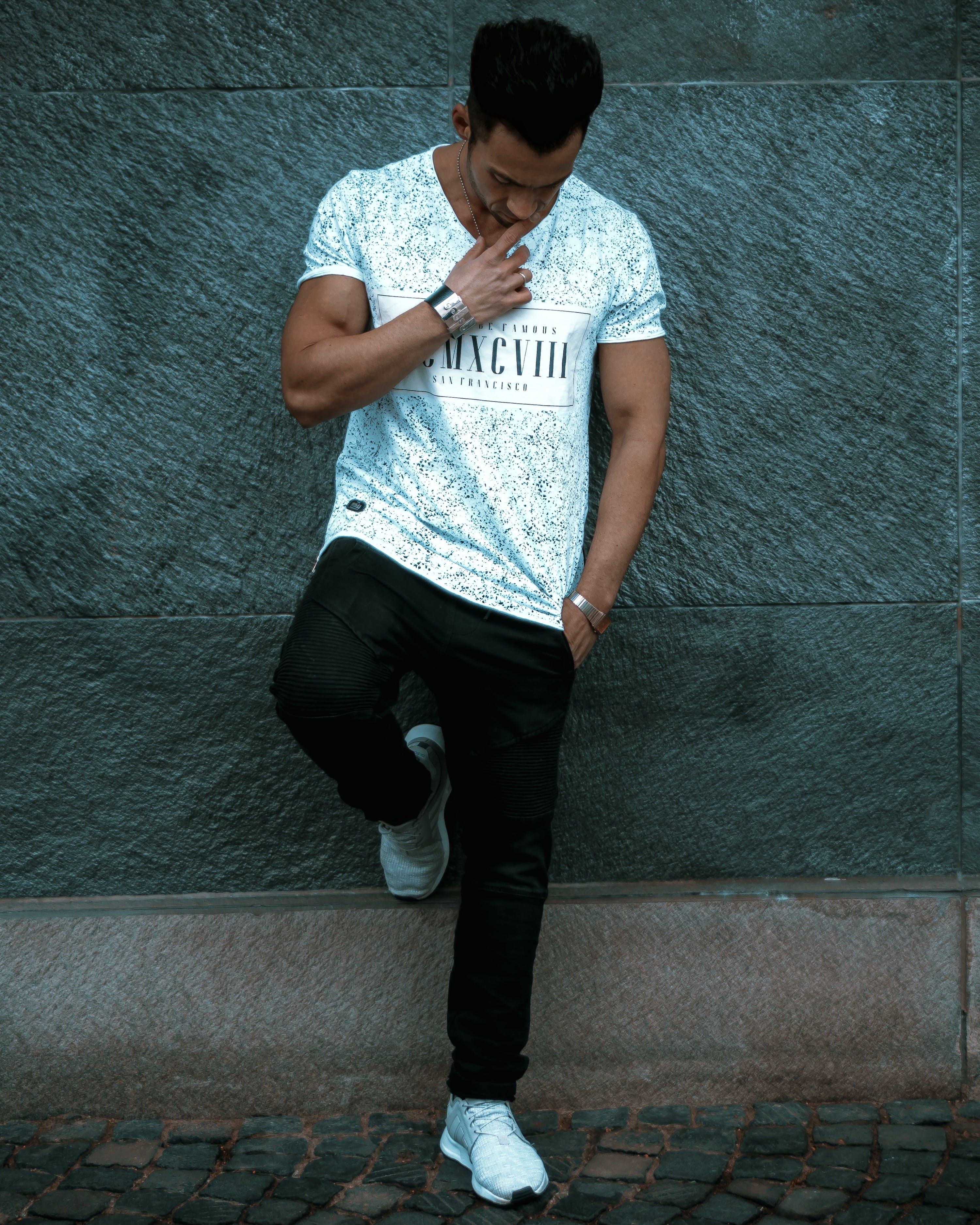 Man Wearing White T-shirt and Black Pants