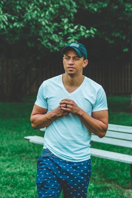 Photo of Man Wearing V-neck T-shirt