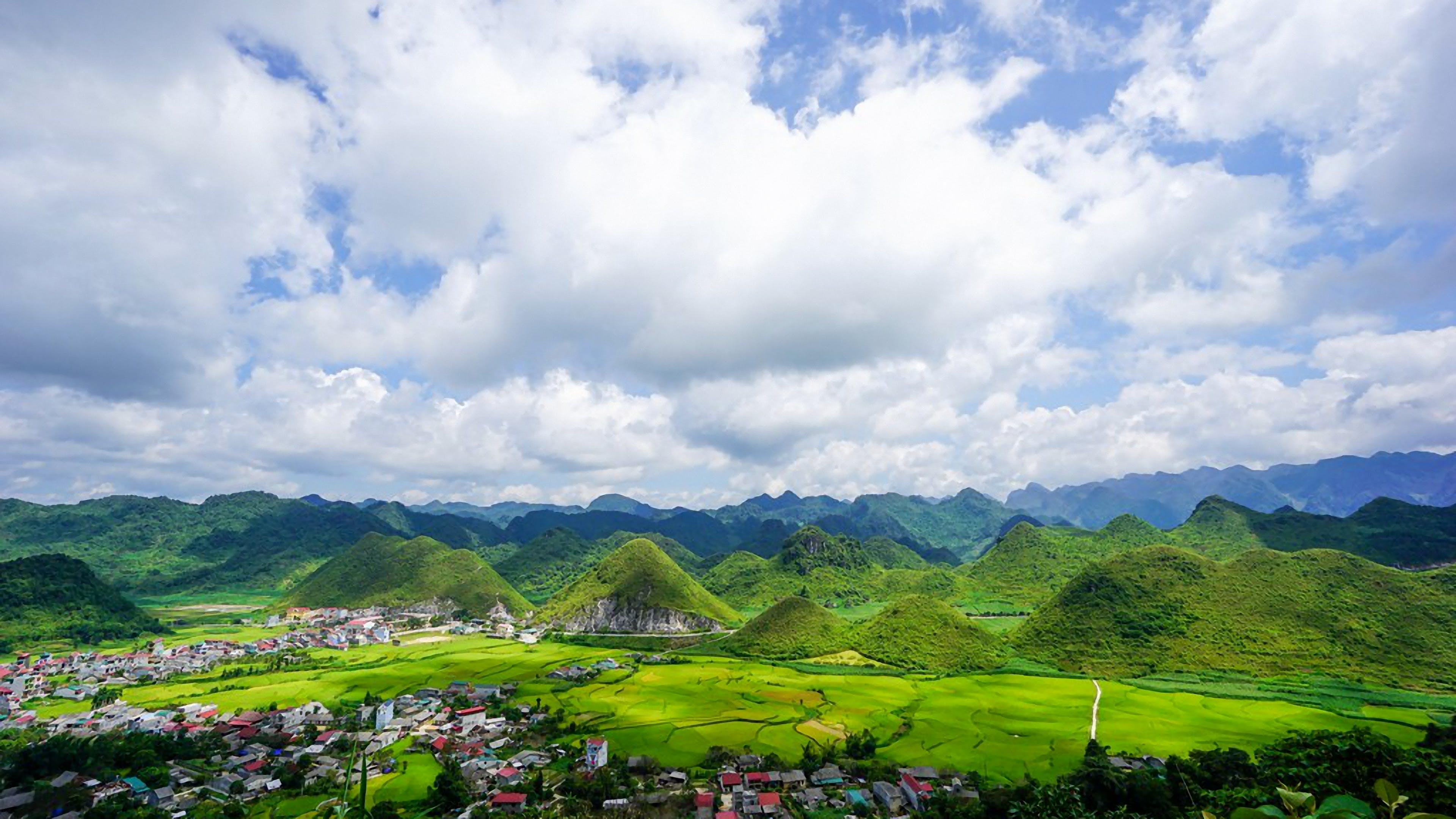 Green Hills Under Cloudy Sky