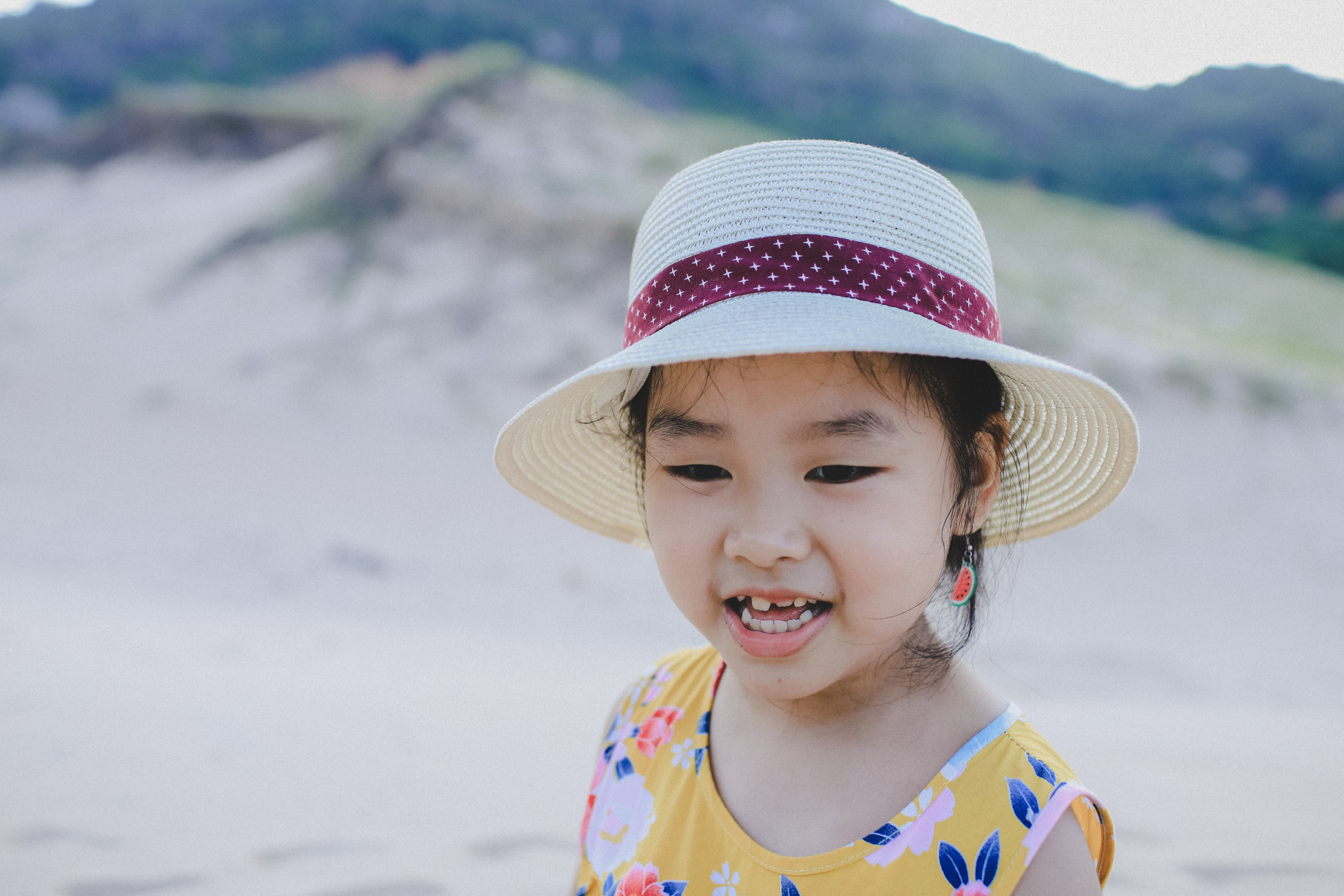 Girl Wearing White Hat Smiling