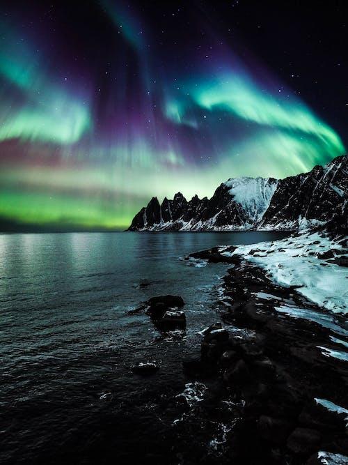 Photos gratuites de aurore boréale, aurore boréales, espace extérieur, lac