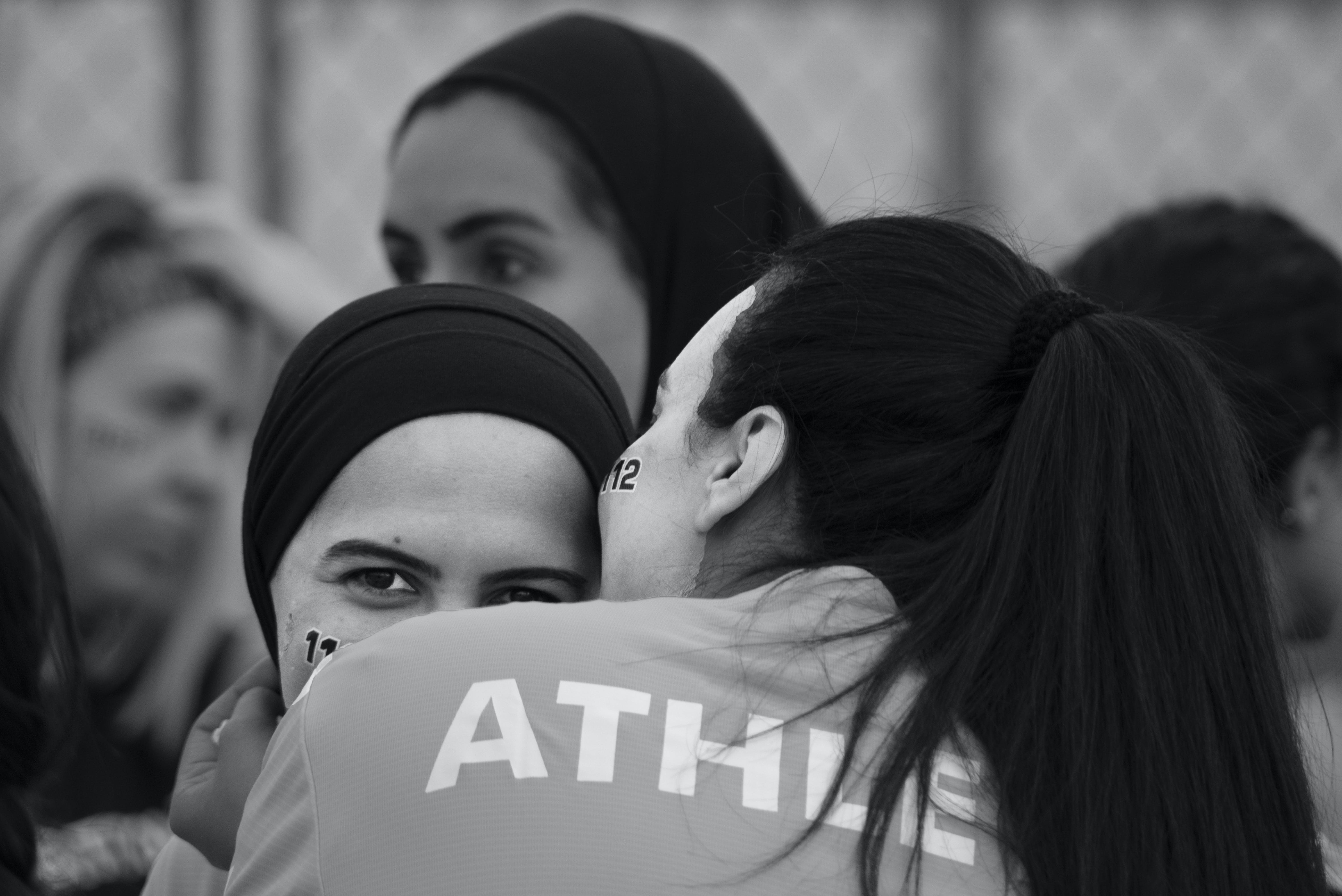 Grayscale Photography of Women Hugging