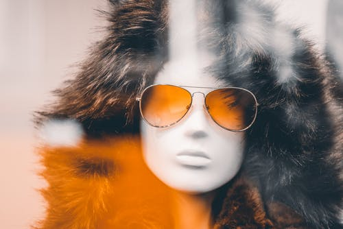 Mannequin Wearing Fur Coat And Sunglasses
