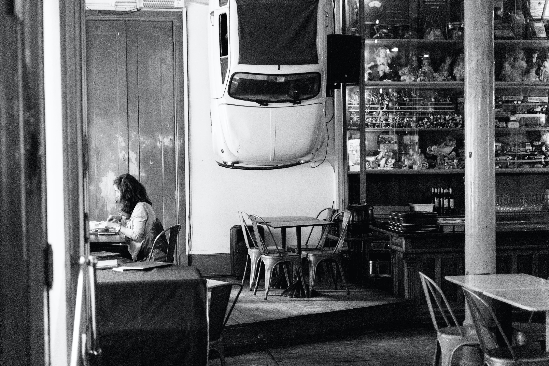 Grayscale Photo of Woman Sitting