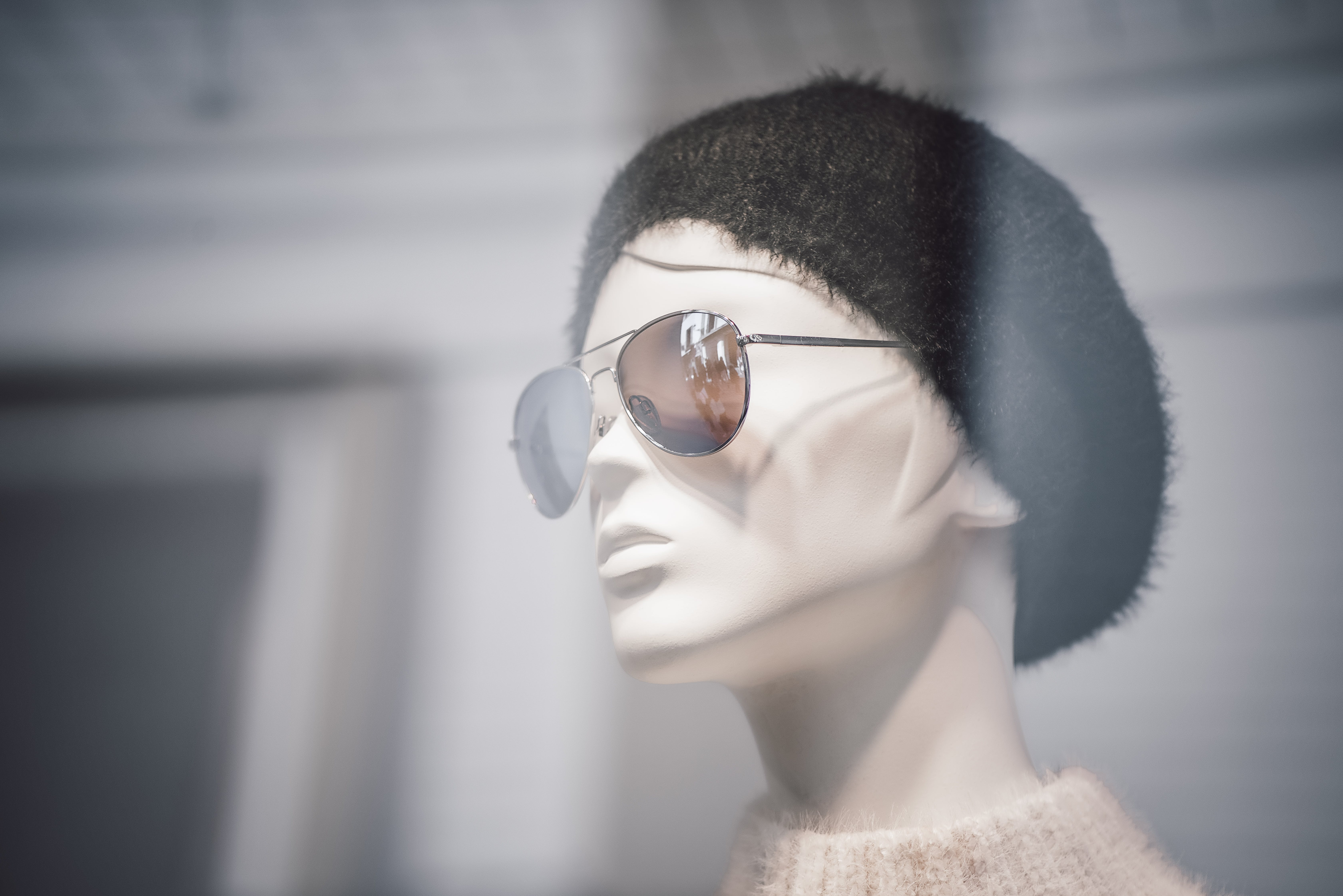 Mannequin Wearing Sunglasses and Black Cap