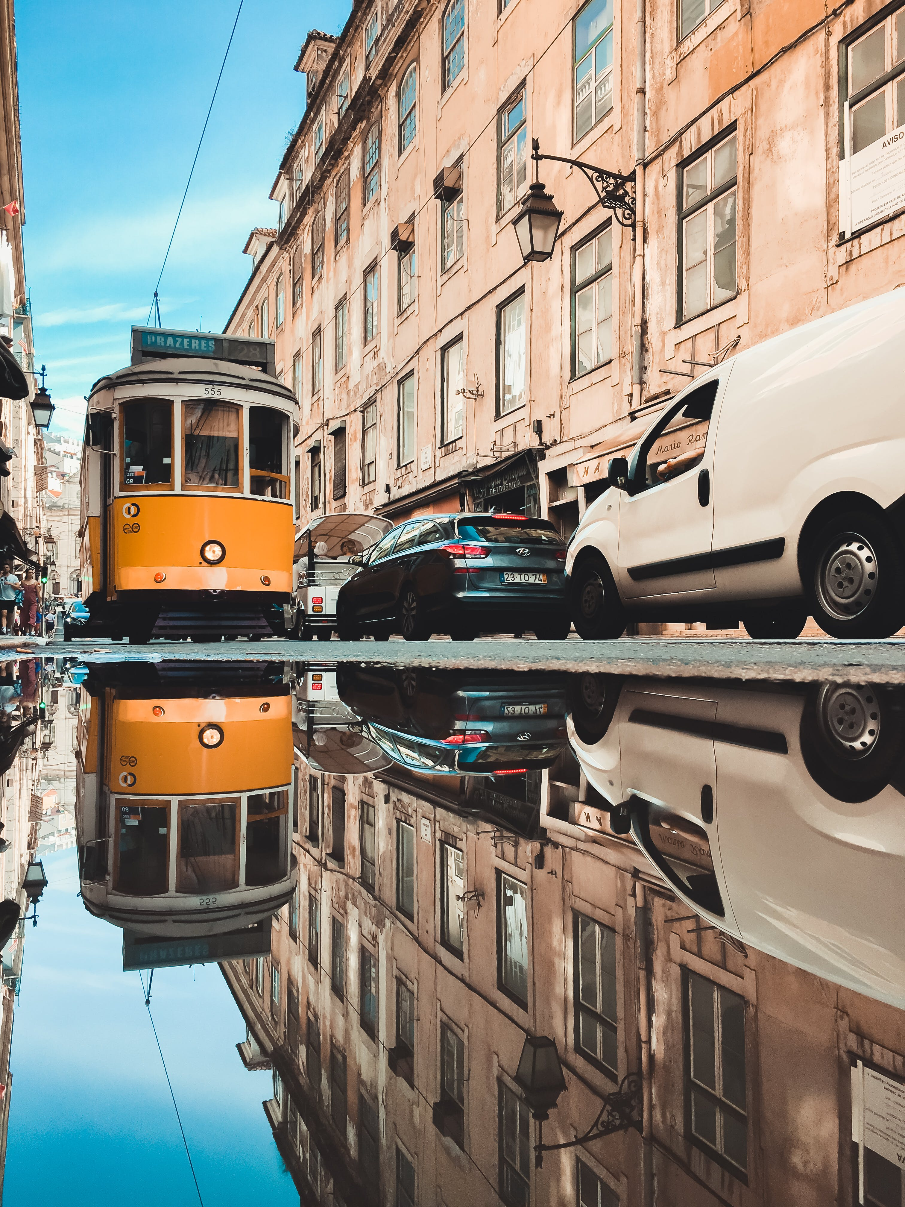 Reflection of Tram in Puddle