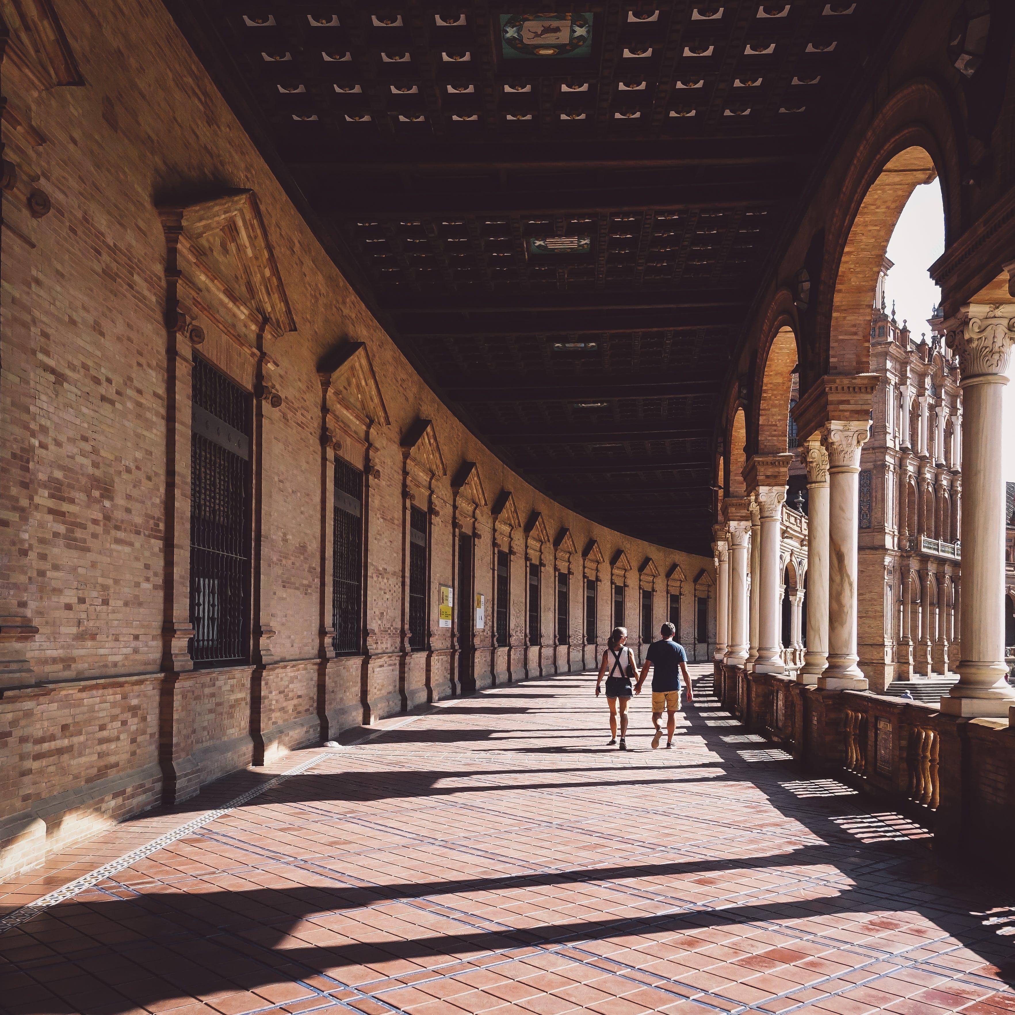Man And Woman Walking On Hallway