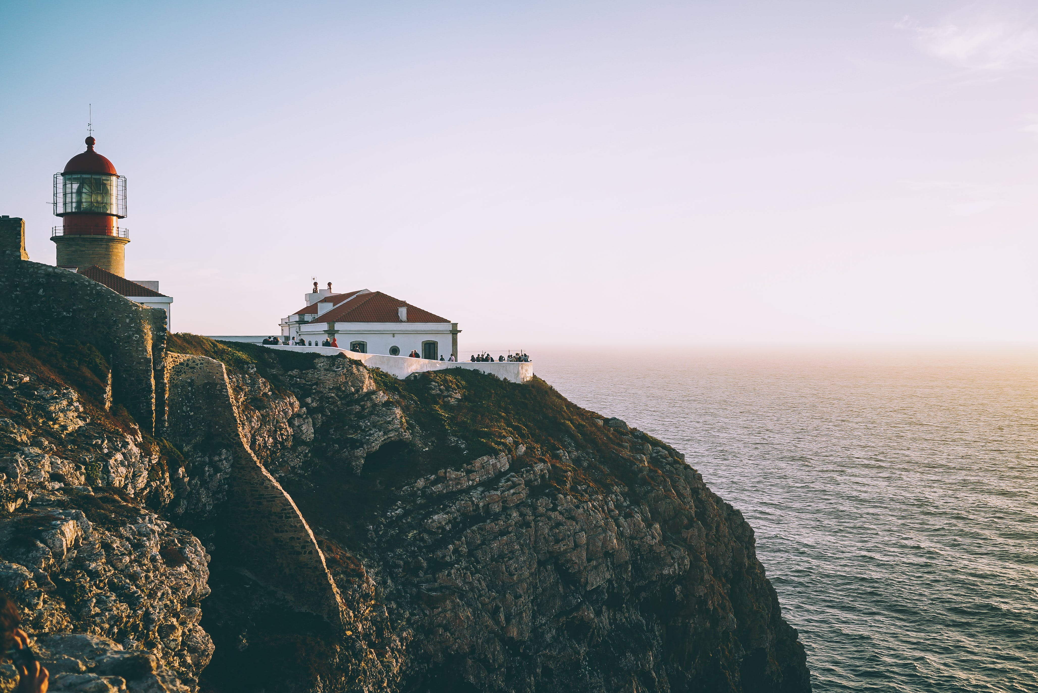 Lighthouse on Cliff Beside Body of Water