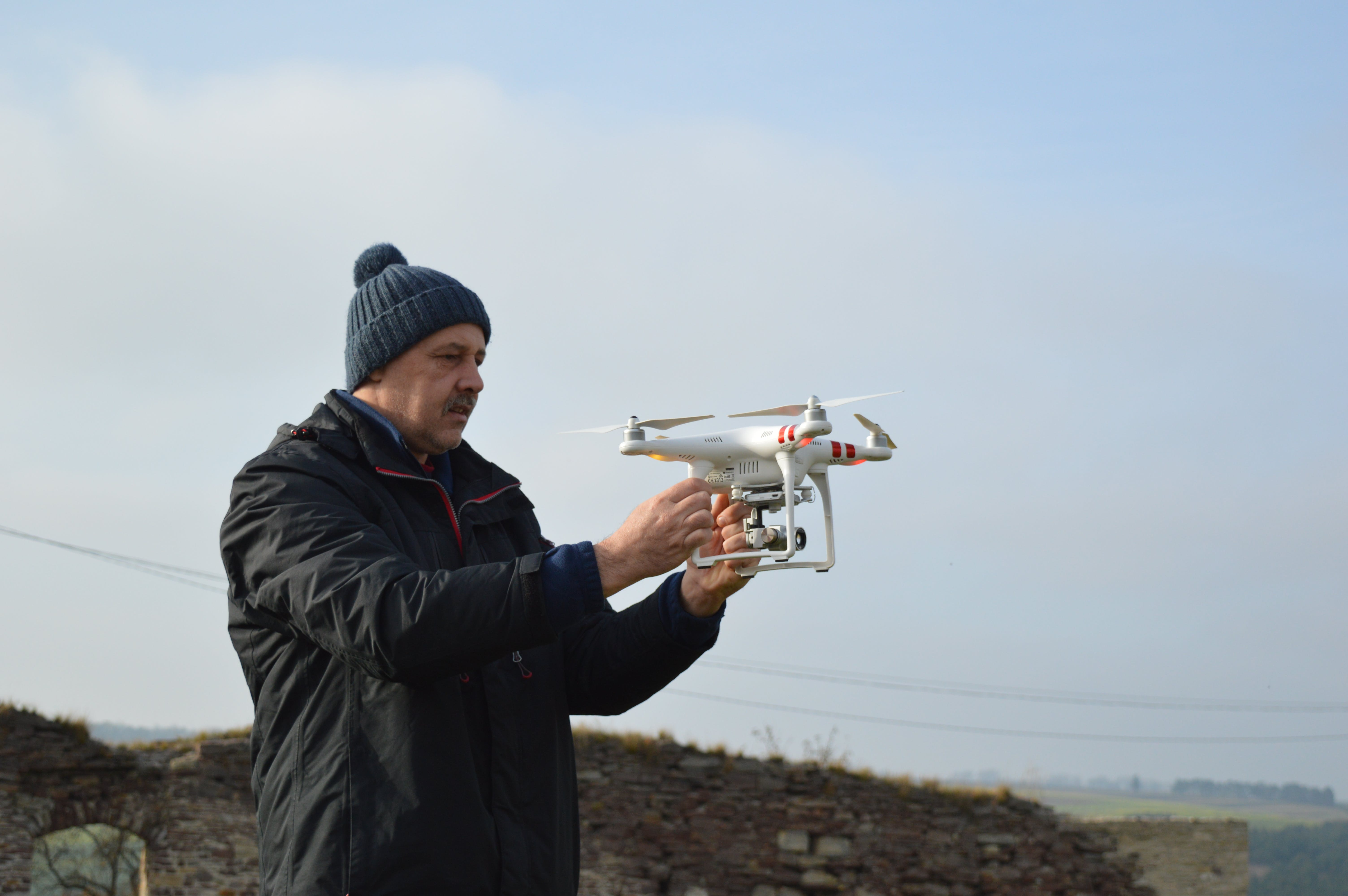Photo of Man Holding a Drone Camera