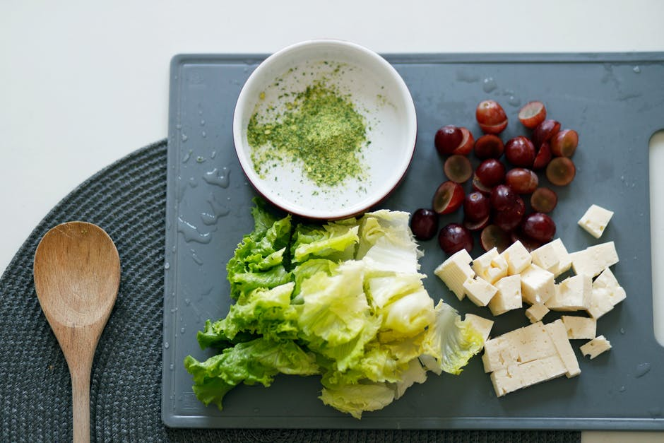 Slice tofu dates and lettuce on grey chopping board
