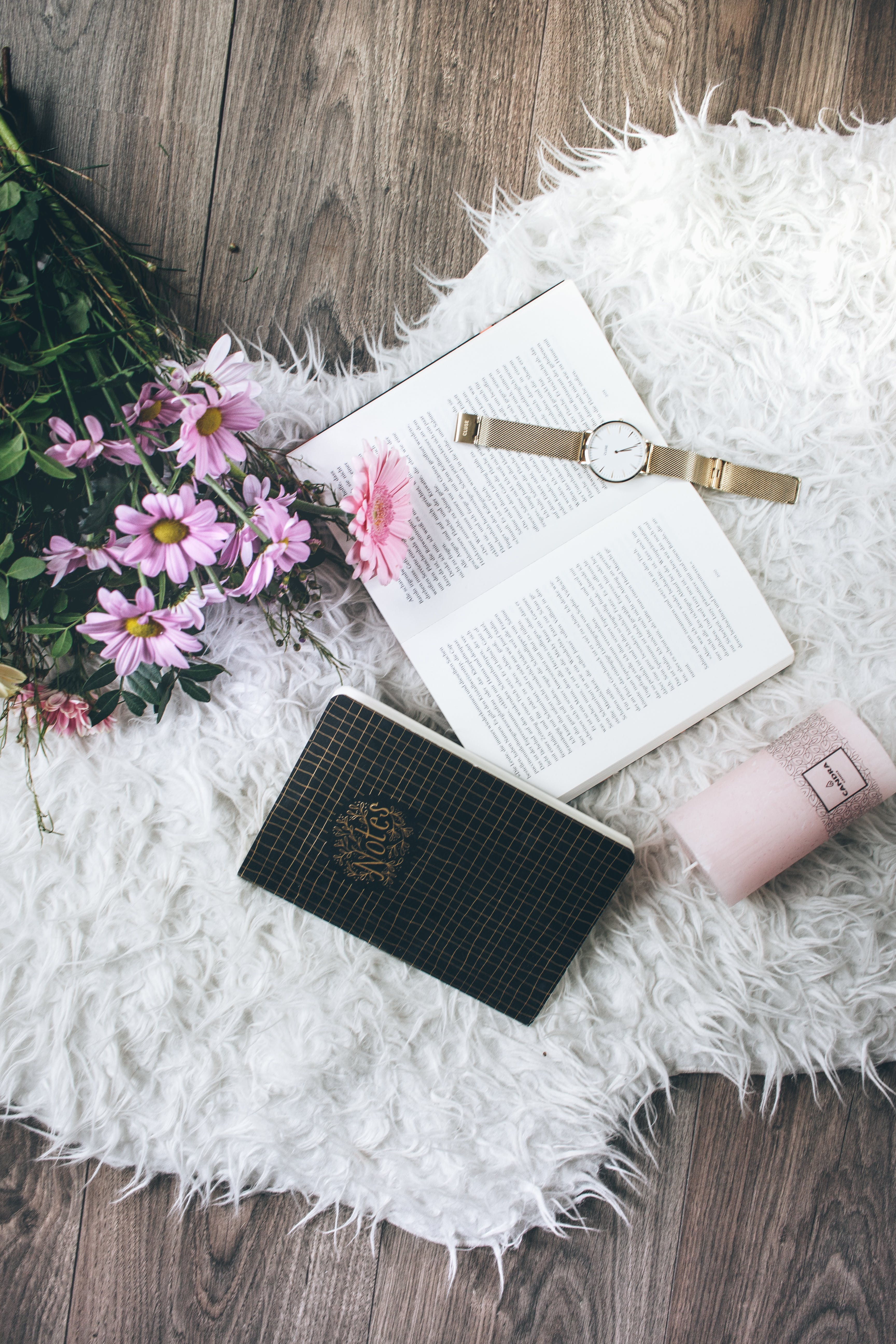 Flatlay Photo of a Watch on Book