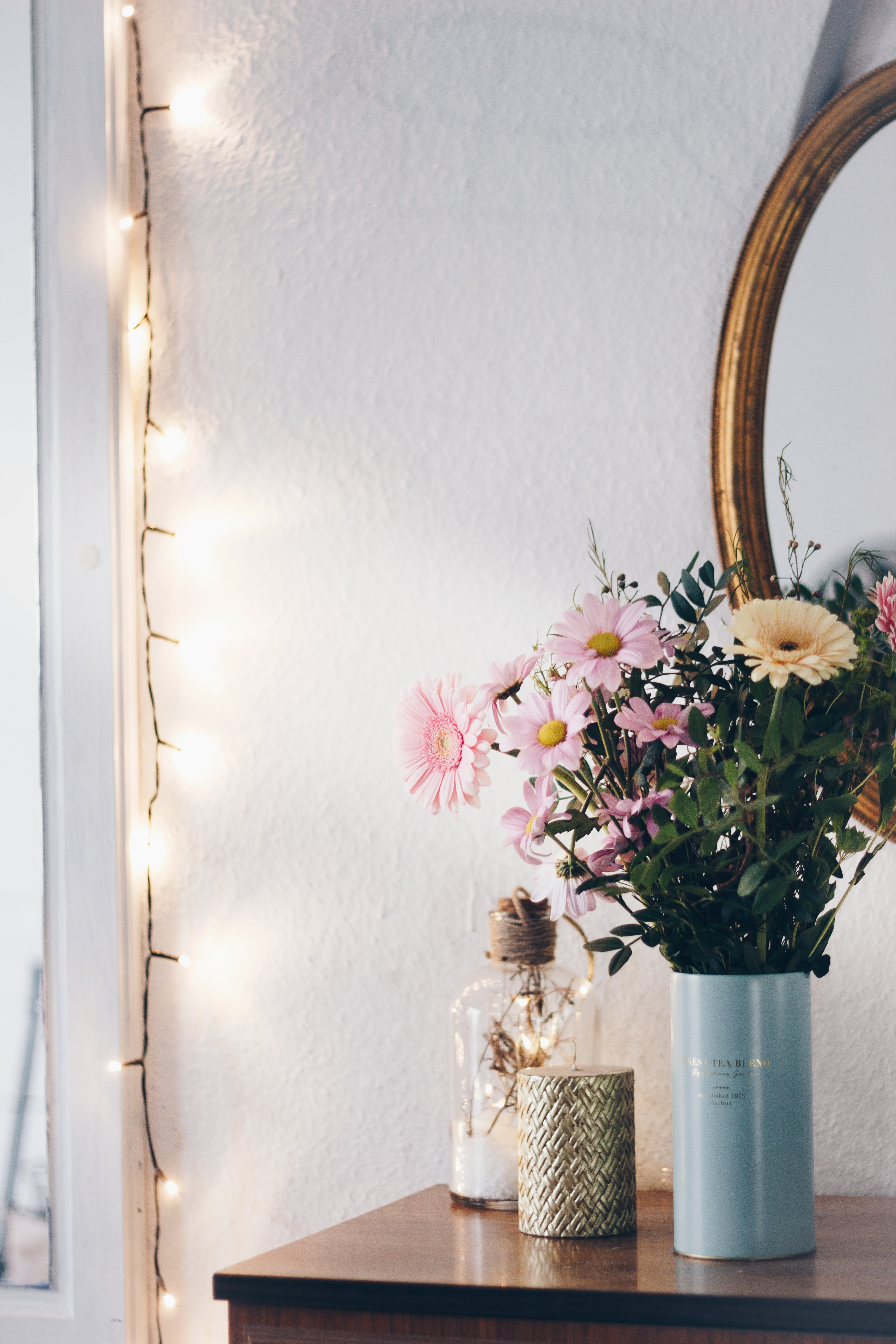 Pink and Yellow Flowers in Blue Vase