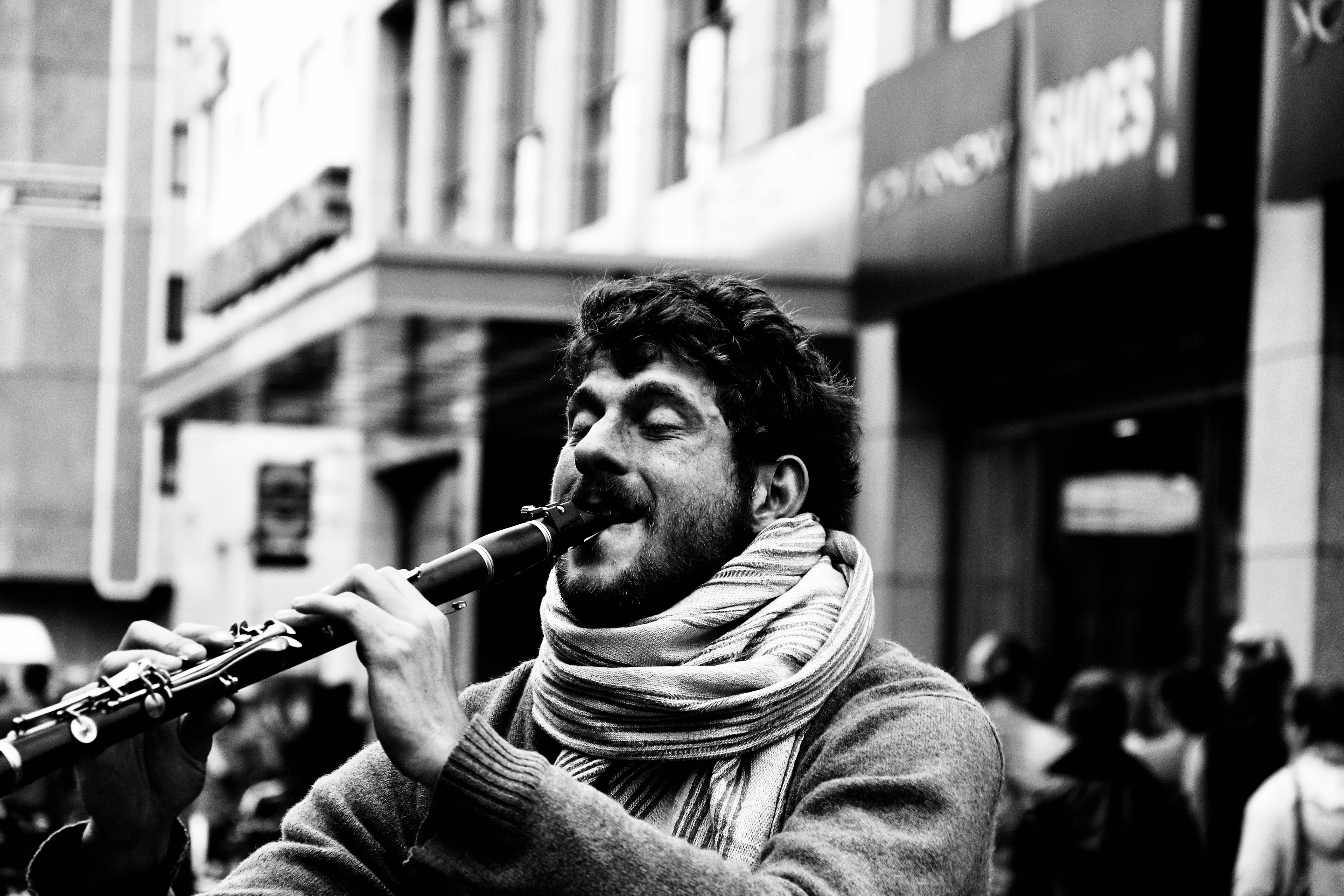 Grayscale Photography of Man Playing Clarinet