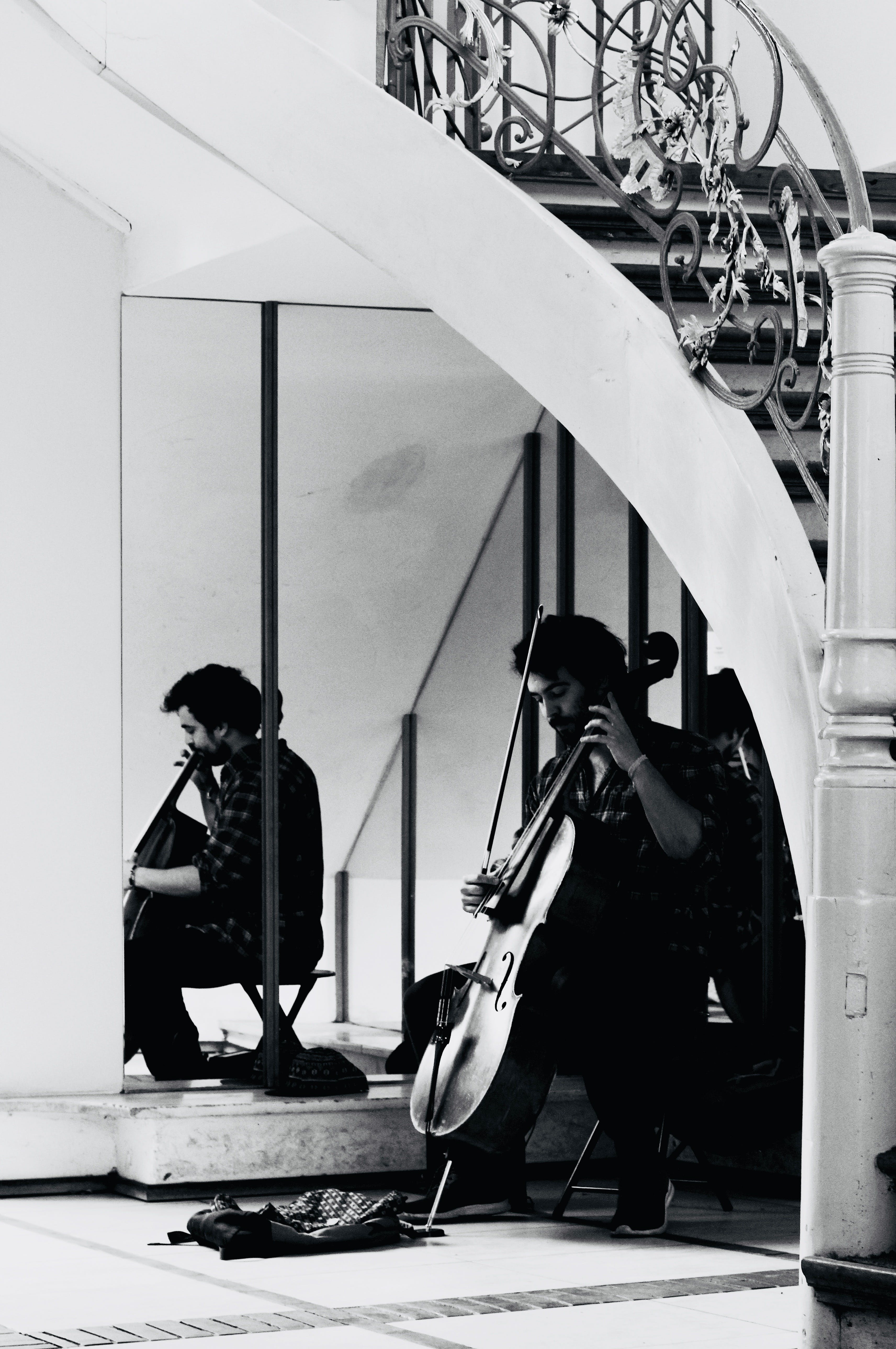 Grayscale Photo of a Man Playing Cello