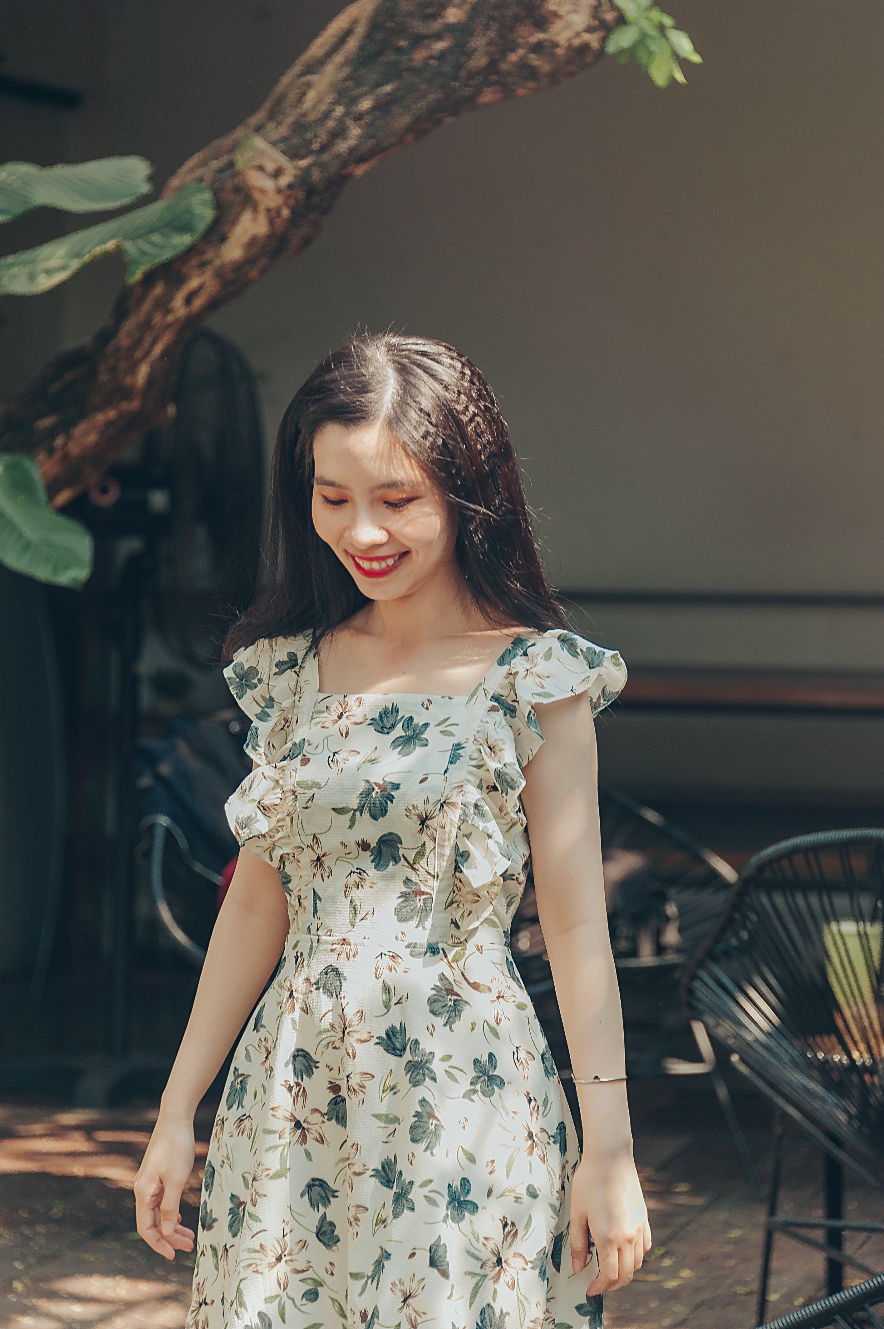 Woman Wearing Floral Dress Standing Near Tree