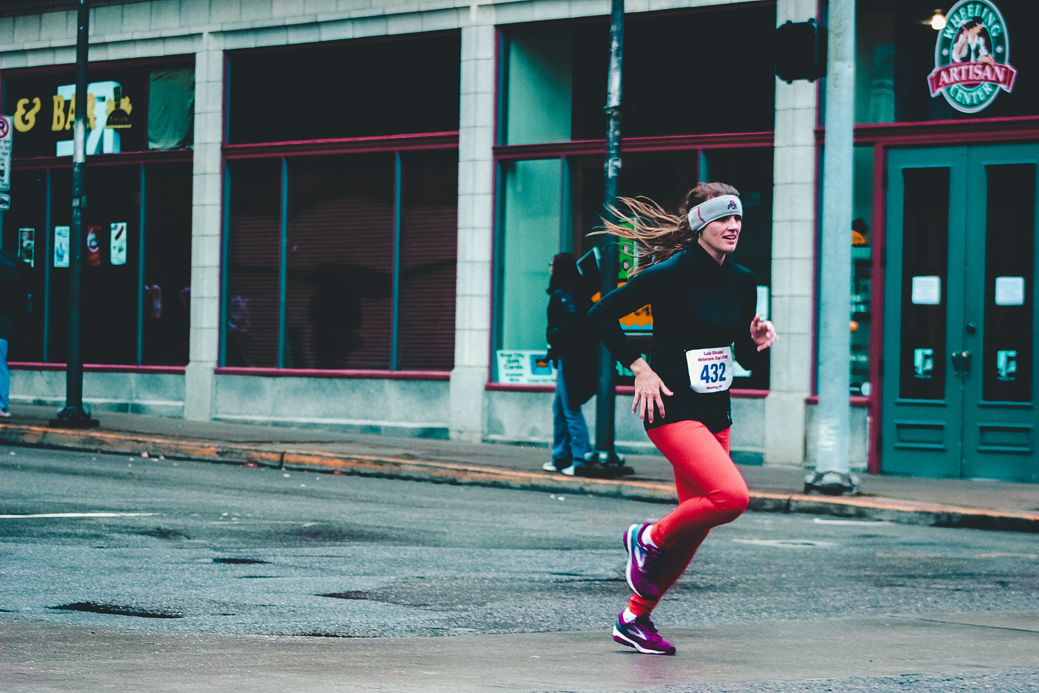 Woman Wearing Red Pants and Black Long-sleeved Top Running