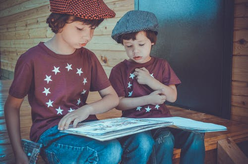Two Boys Reading A Book