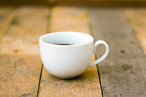 Close-Up Photo of White Teacup