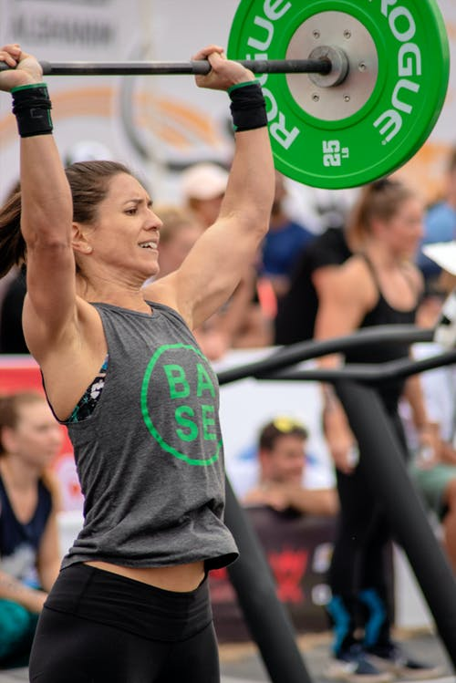 Woman Lifting Green and Black Barbell