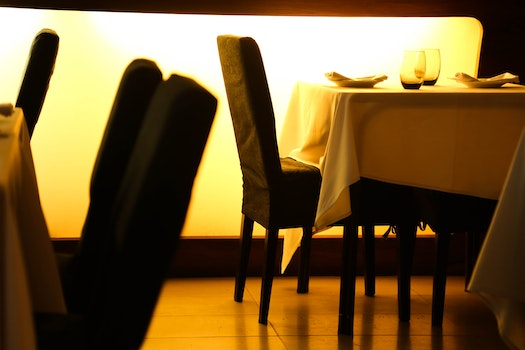 Beige Table Cloth Beside Black Padded Chair