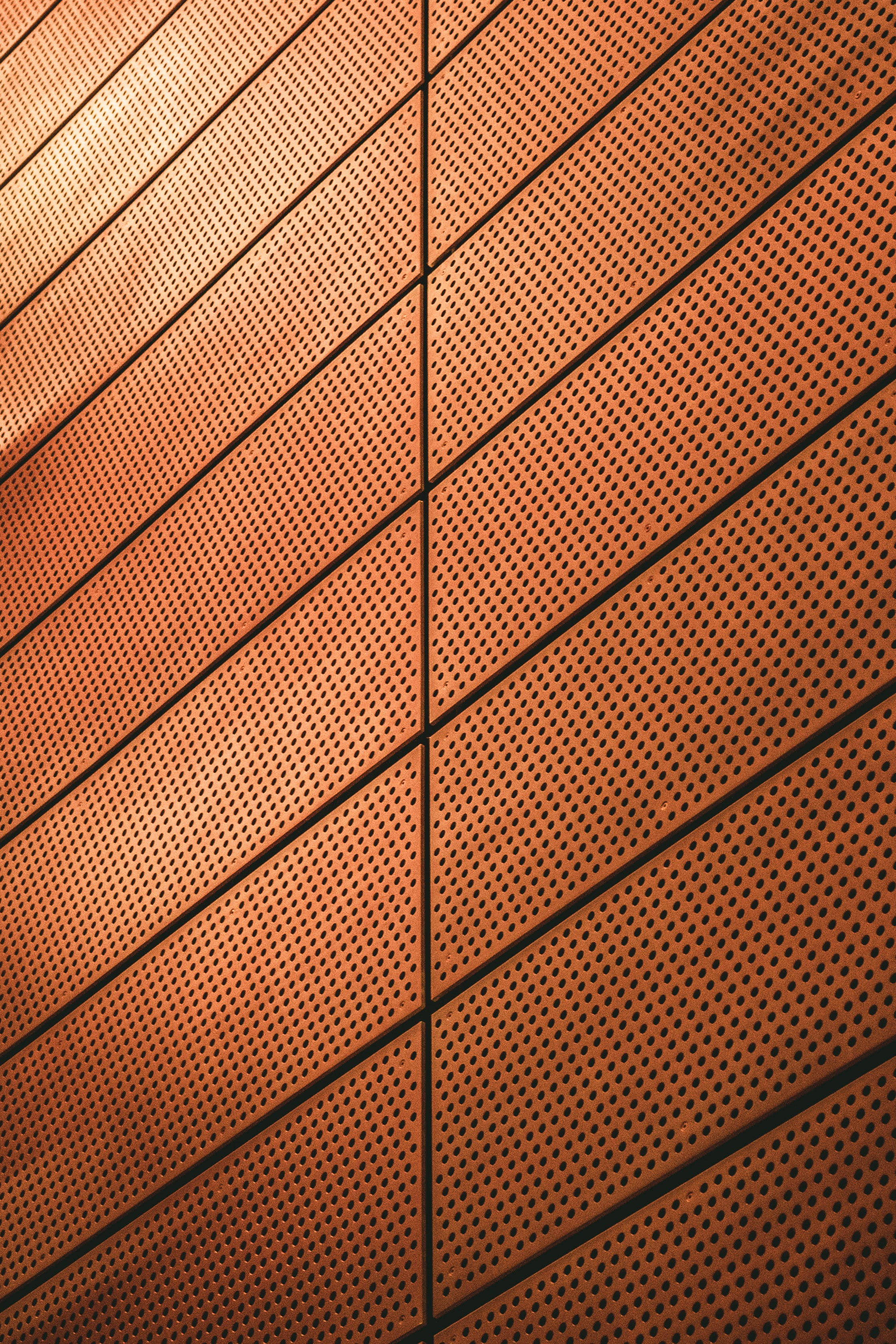 Brown Wall Designed With Holes