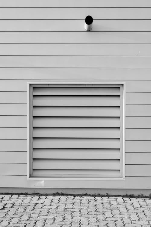 White Wooden Louvered Wall
