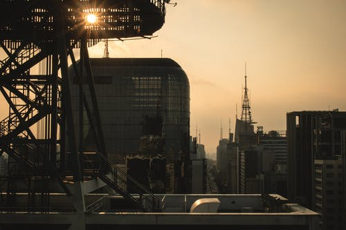 Free stock photo of afternoon, cityscape, flare, sun