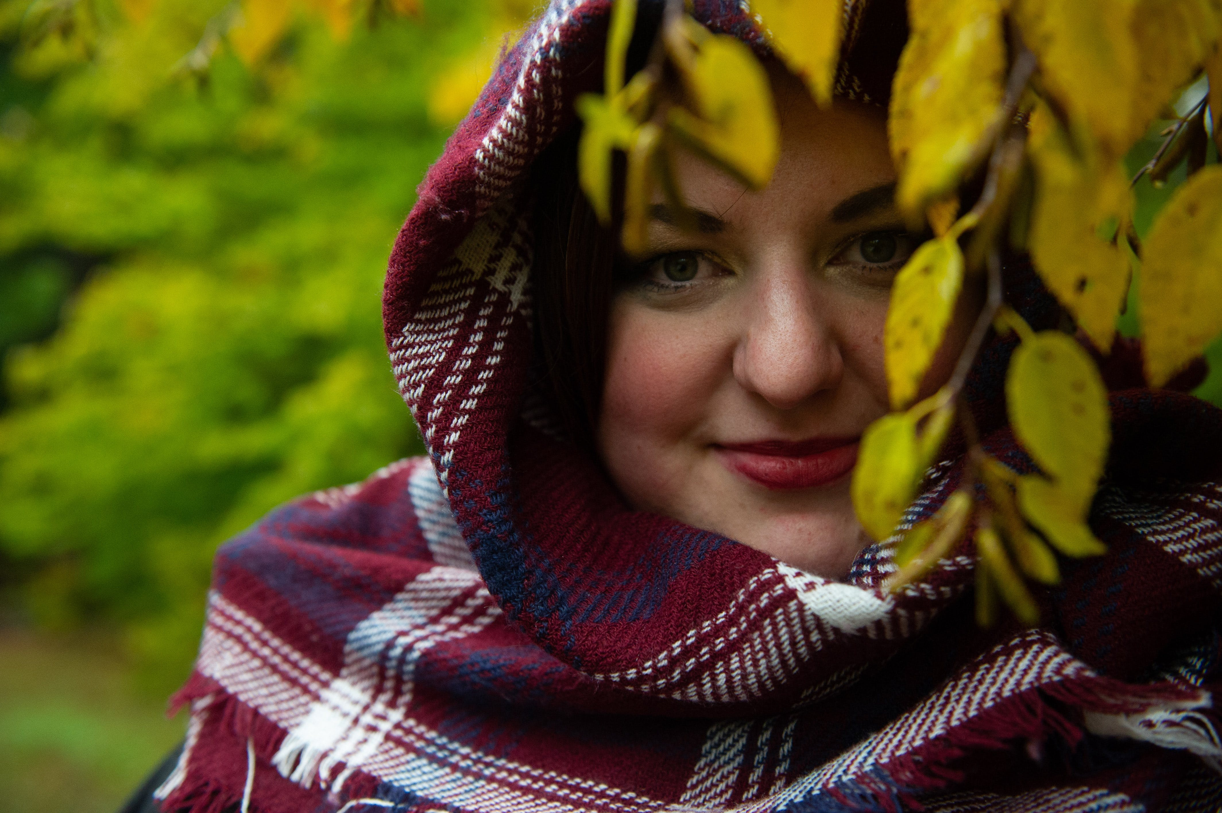 Woman Wearing Red and White Plaid Headscarf