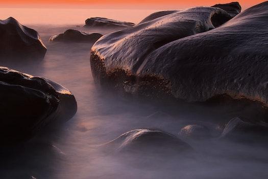 Black Rock Beside Body of Water Frame Painting