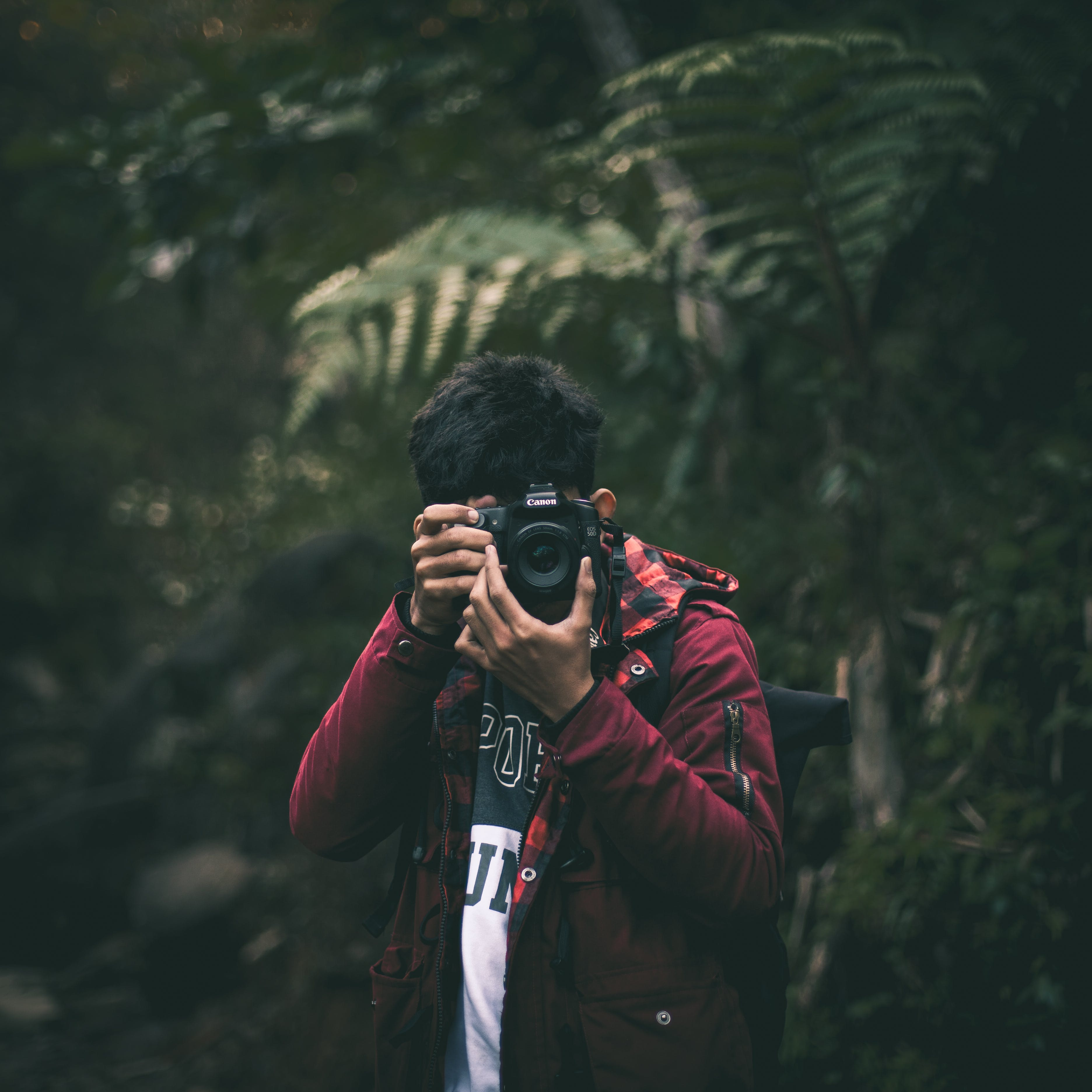 Photo of Man Holding a Camera
