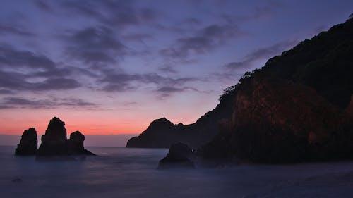 Foto profissional grátis de água, alvorecer, beira-mar, litoral