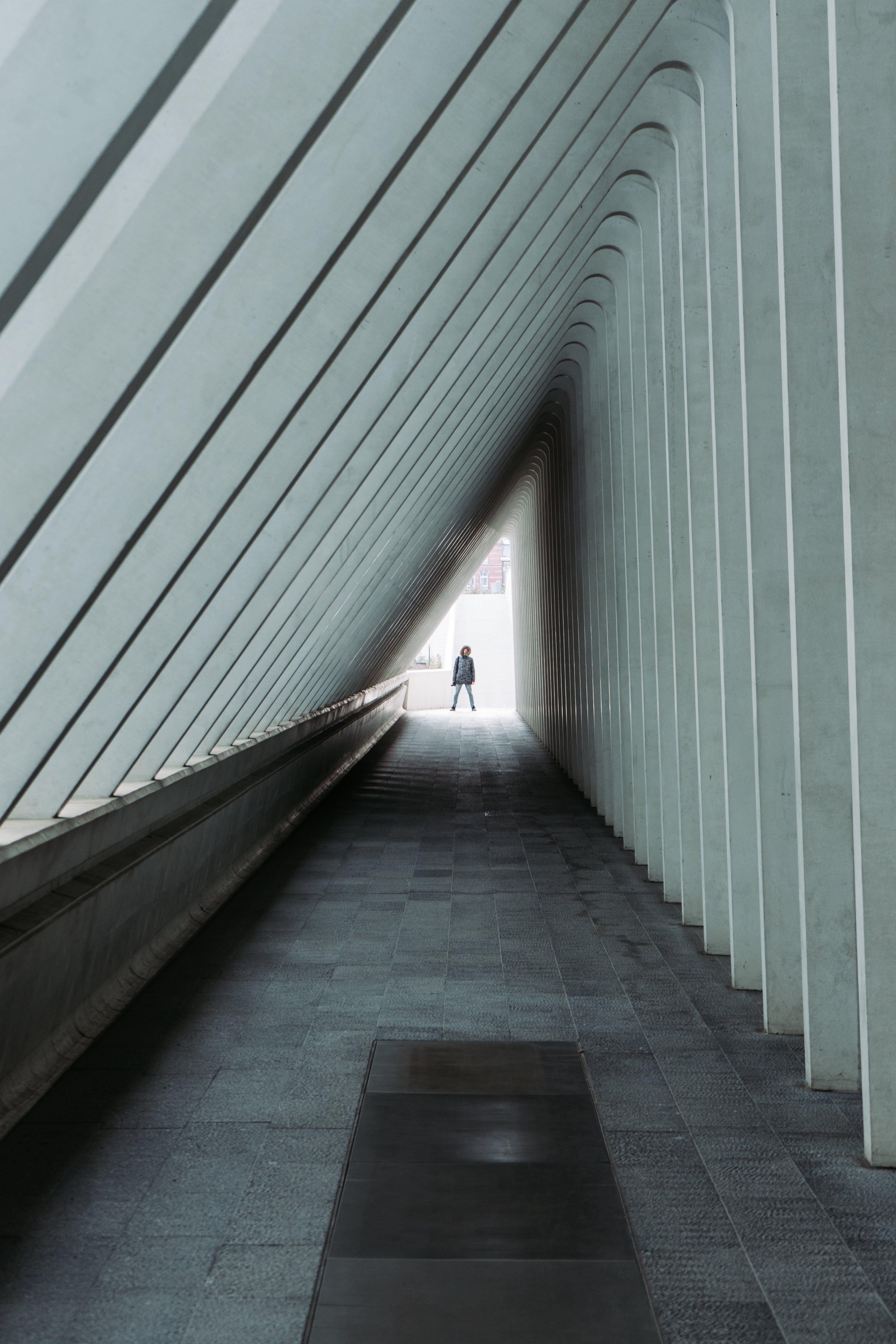 Person Standing at the End of a Hallway
