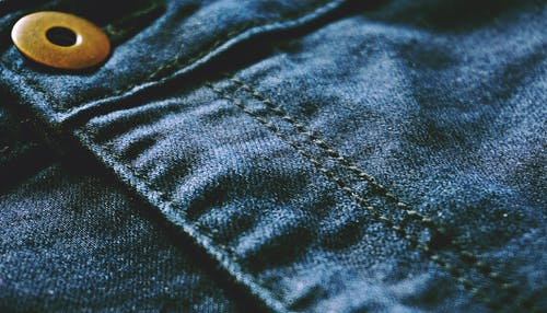 Blue Denim Textile With Brown Button