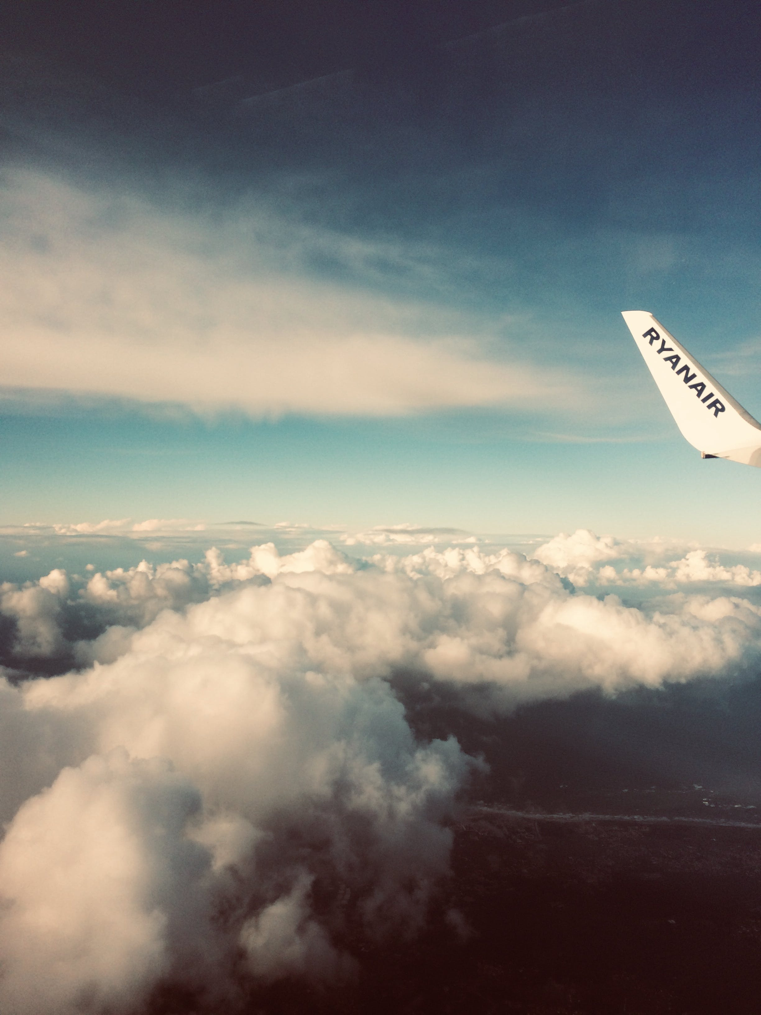 Plane's Tail Near Clouds