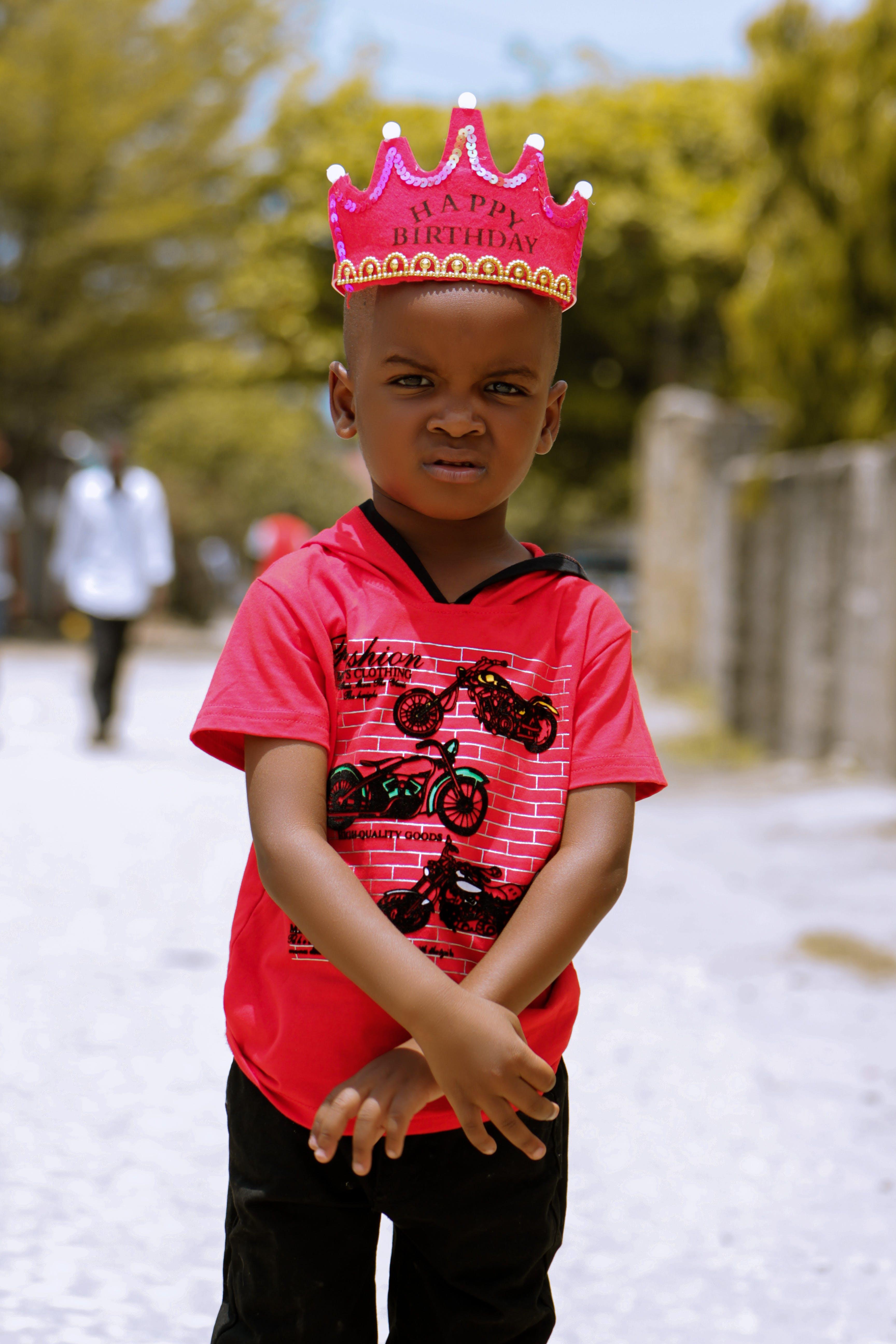 Photo of Boy Wearing Crown