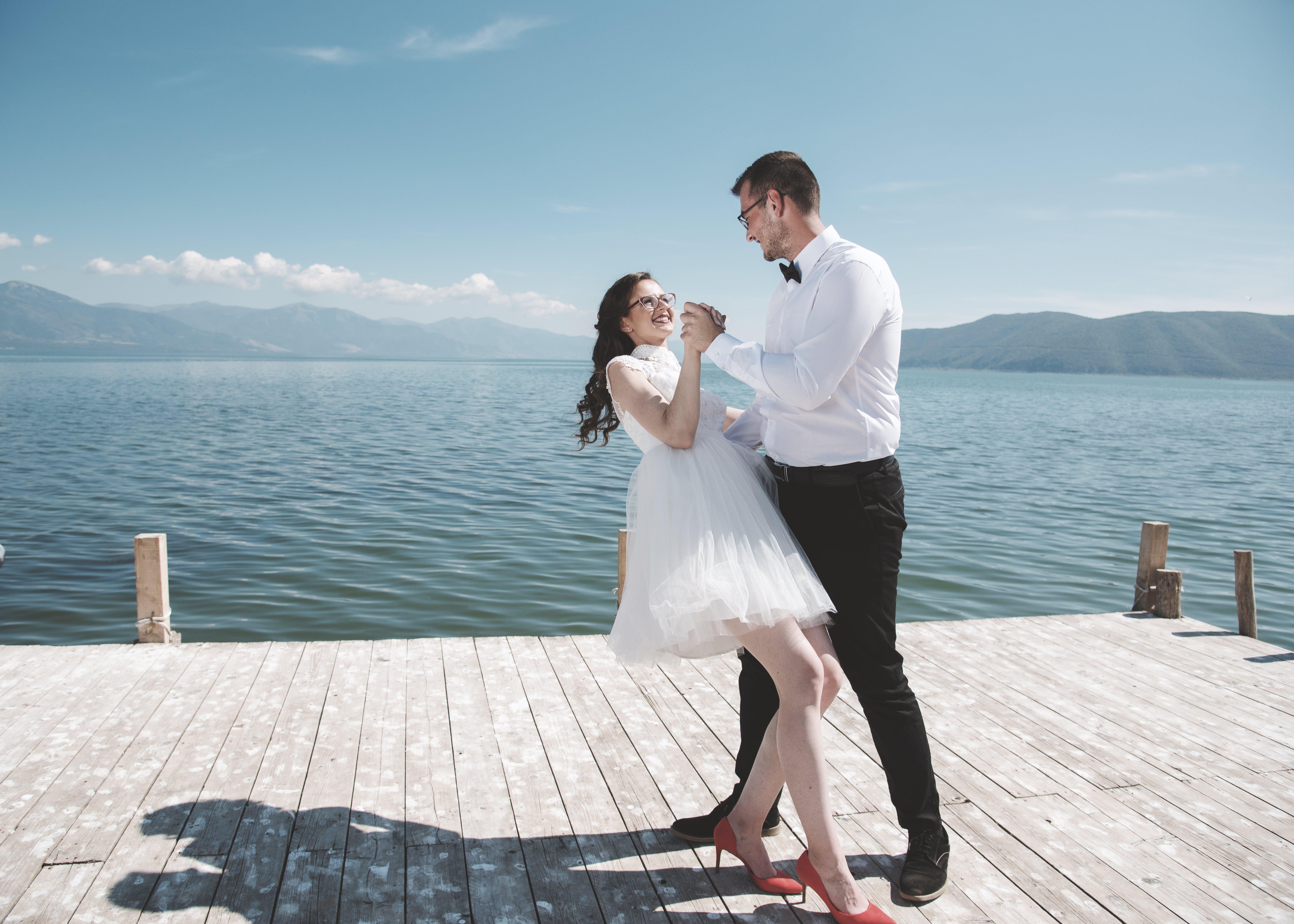 Man and Woman Dancing on Dock