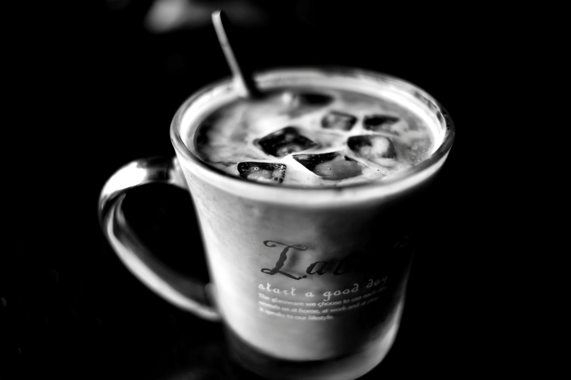 Grayscale Photo of Cup With Ice Cubes
