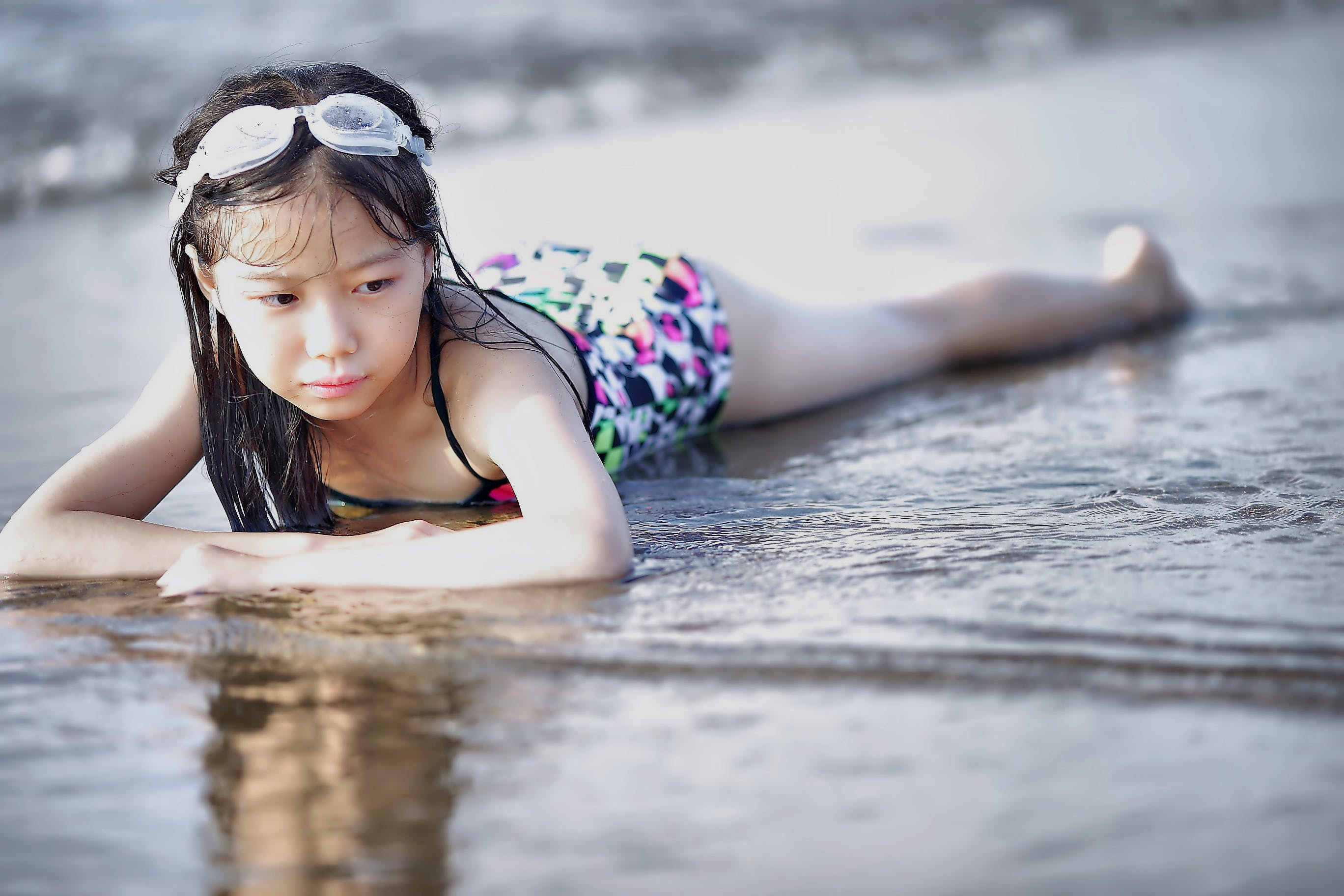 Selective Color Photography of Girl Lying on Beach