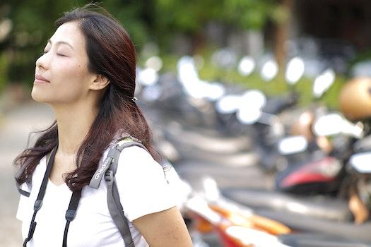 Macro Photography of Woman Wearing White Vneck Shirt