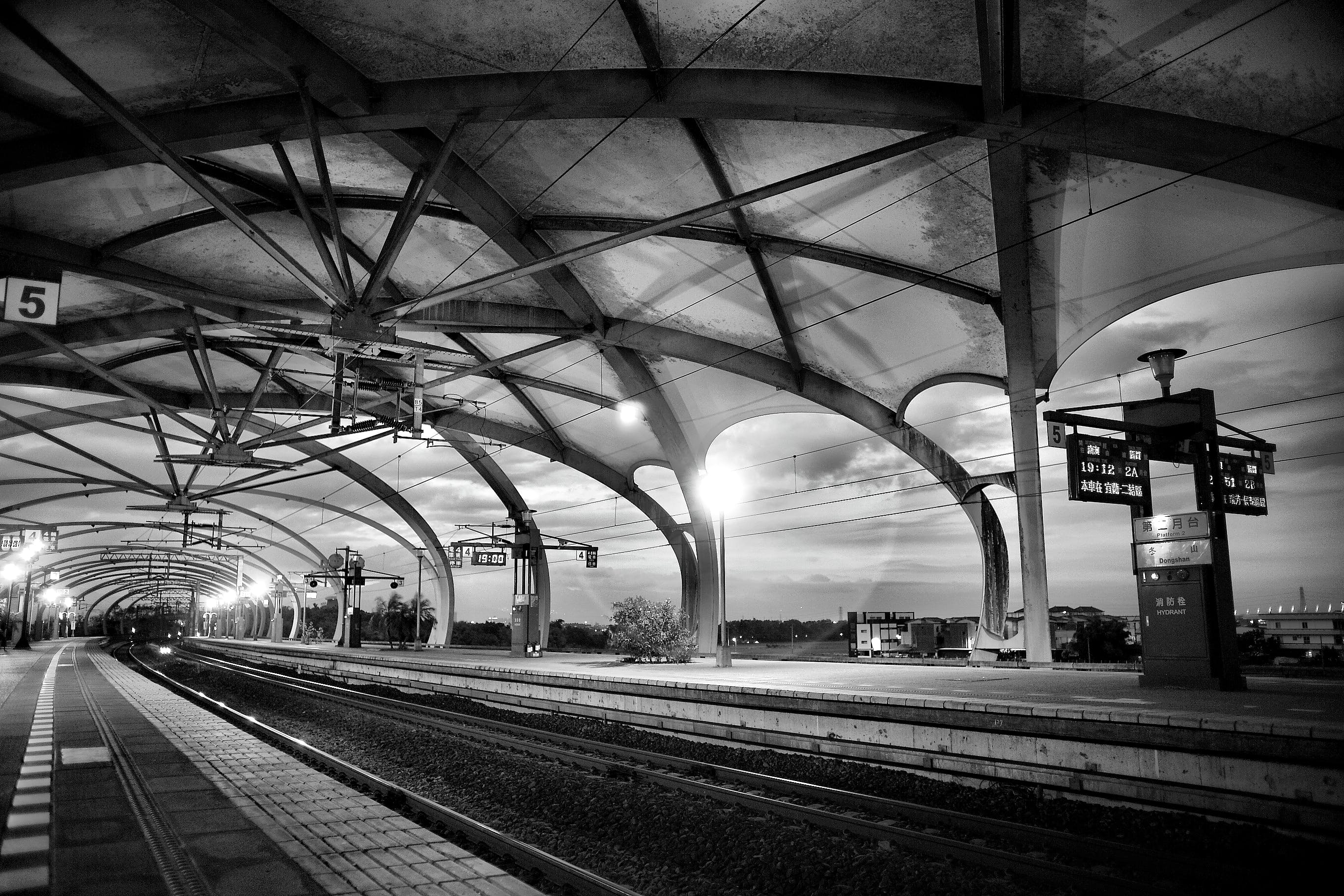 Grayscale Architectural Photography of Empty Train Station