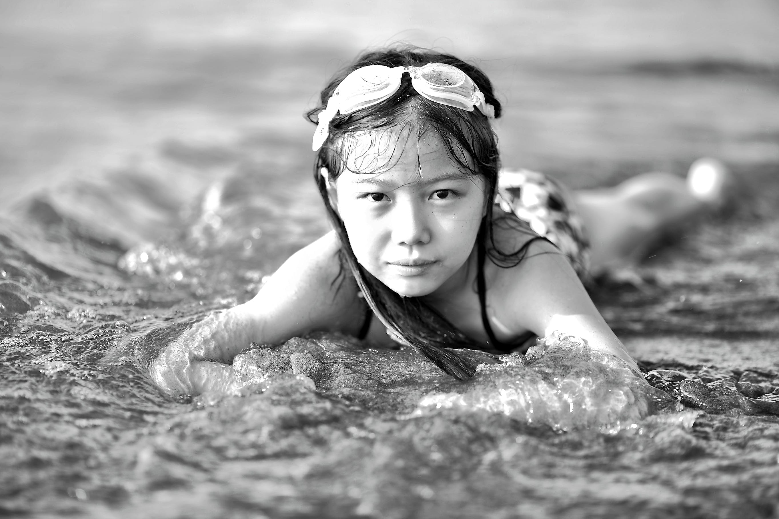 Girl Wearing Goggles on Beach in Black and White